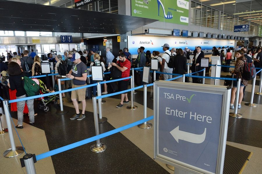 Passengers enter checkpoint 8 in Terminal 3 for TSA inspection at O'Hare.