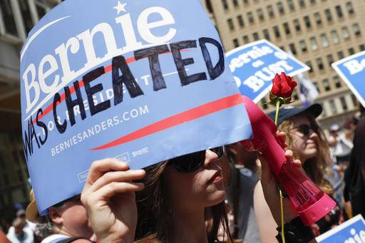 A supporter of Sen. Bernie Sanders, I-Vt., listens during a rally near City Hall in Philadelphia, Tuesday, July 26, 2016, during the second day of the Democratic National Convention. (AP Photo/John Minchillo)