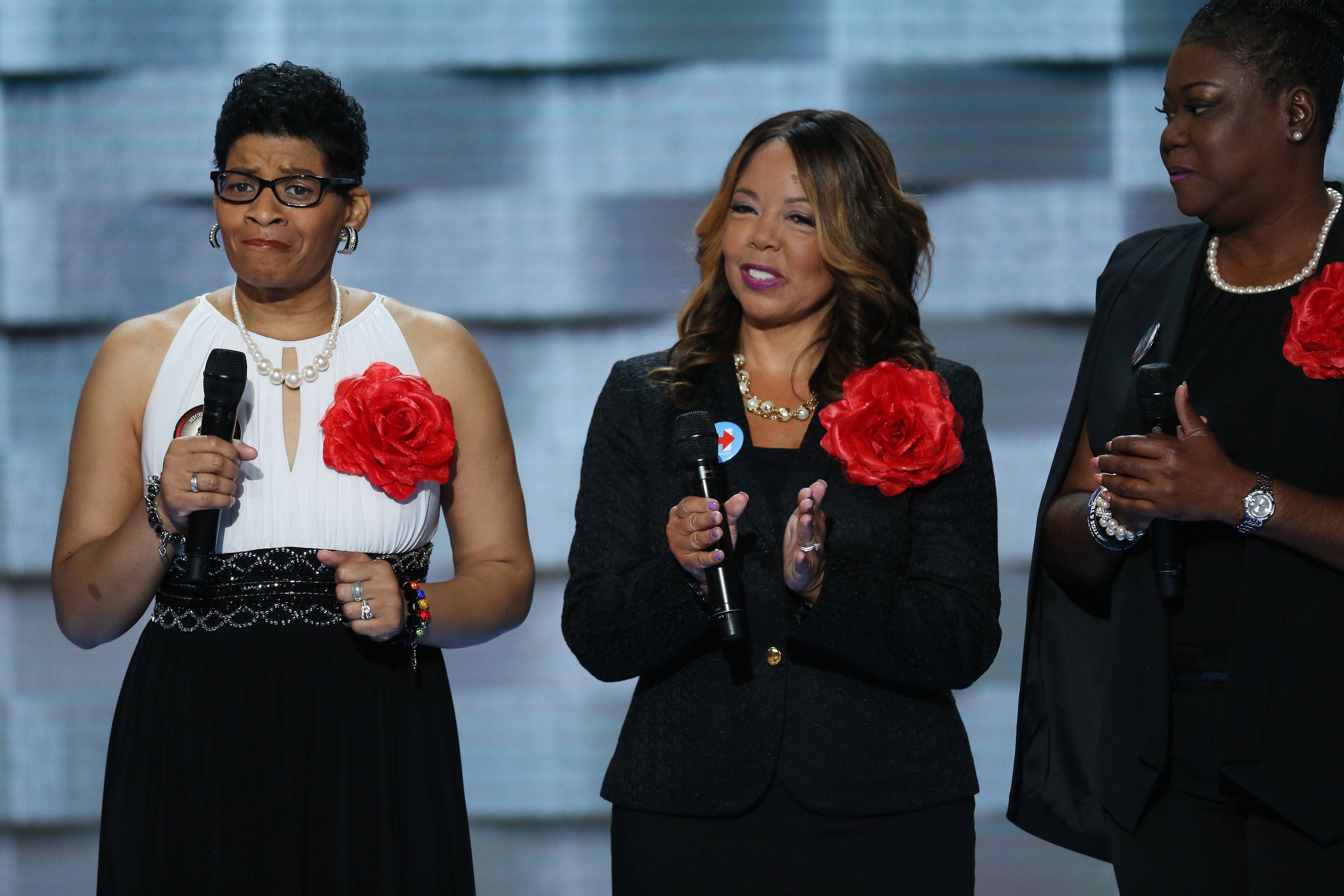 Geneva Reed-Veal left, and other members of Mothers of the Movement stand on stage during the Democratic National Convention in Philadelphia on Tuesday. Democrats began their presidential nominating convention Monday with a struggle to fully unite the party, following a dramatic day of internal squabbling and protests.