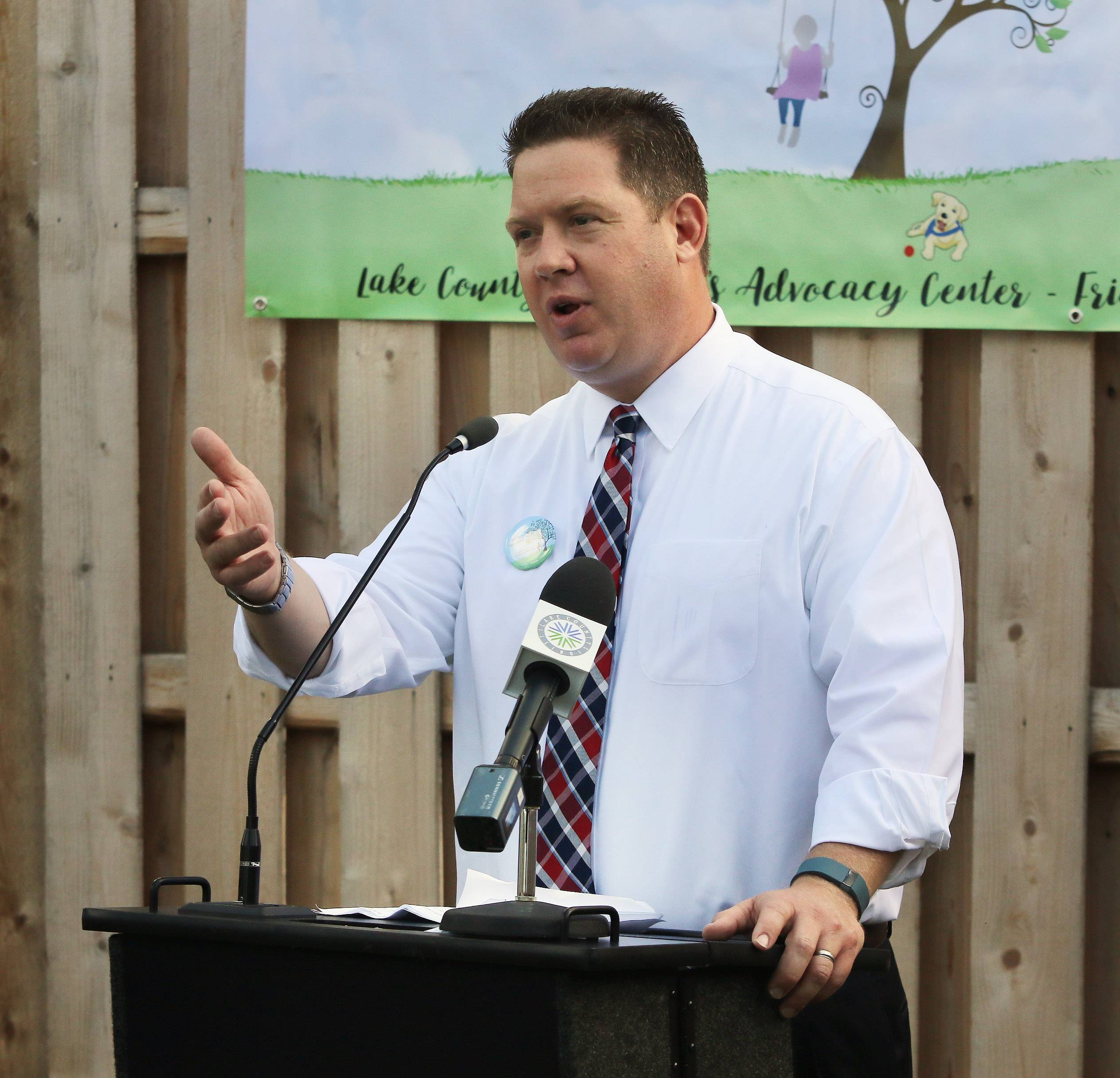 "Lake County State's Attorney Michael Nerheim discusses the need for the Lake County Children's Advocacy Center's new ""healing garden"" Tuesday during the groundbreaking ceremony in Gurnee."