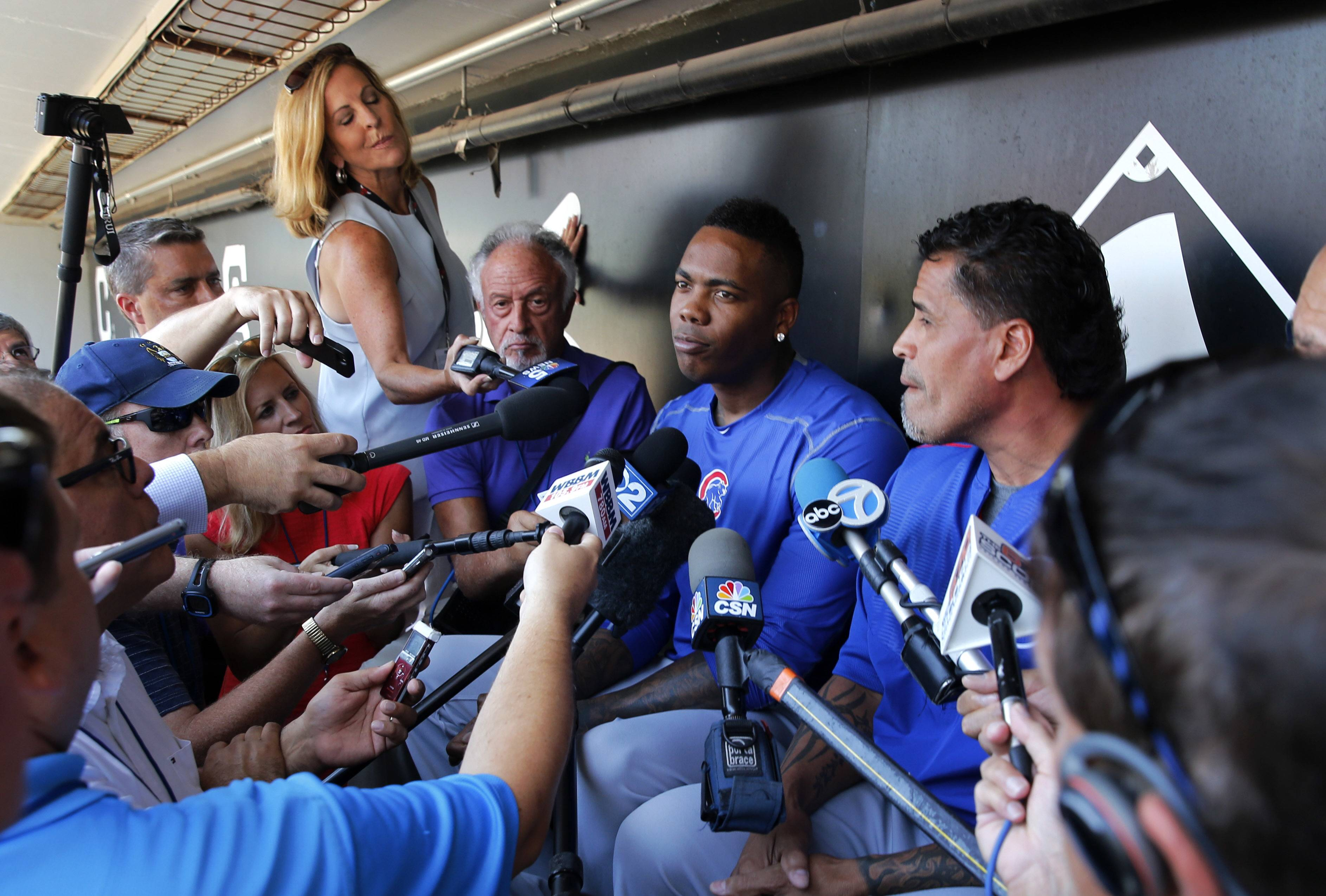 Chicago Cubs reliever Aroldis Chapman, center, listens to a question as he meets reporters before a baseball game between the Chicago White Sox and Cubs Tuesday, July 26, 2016, in Chicago. (AP Photo/Charles Rex Arbogast)