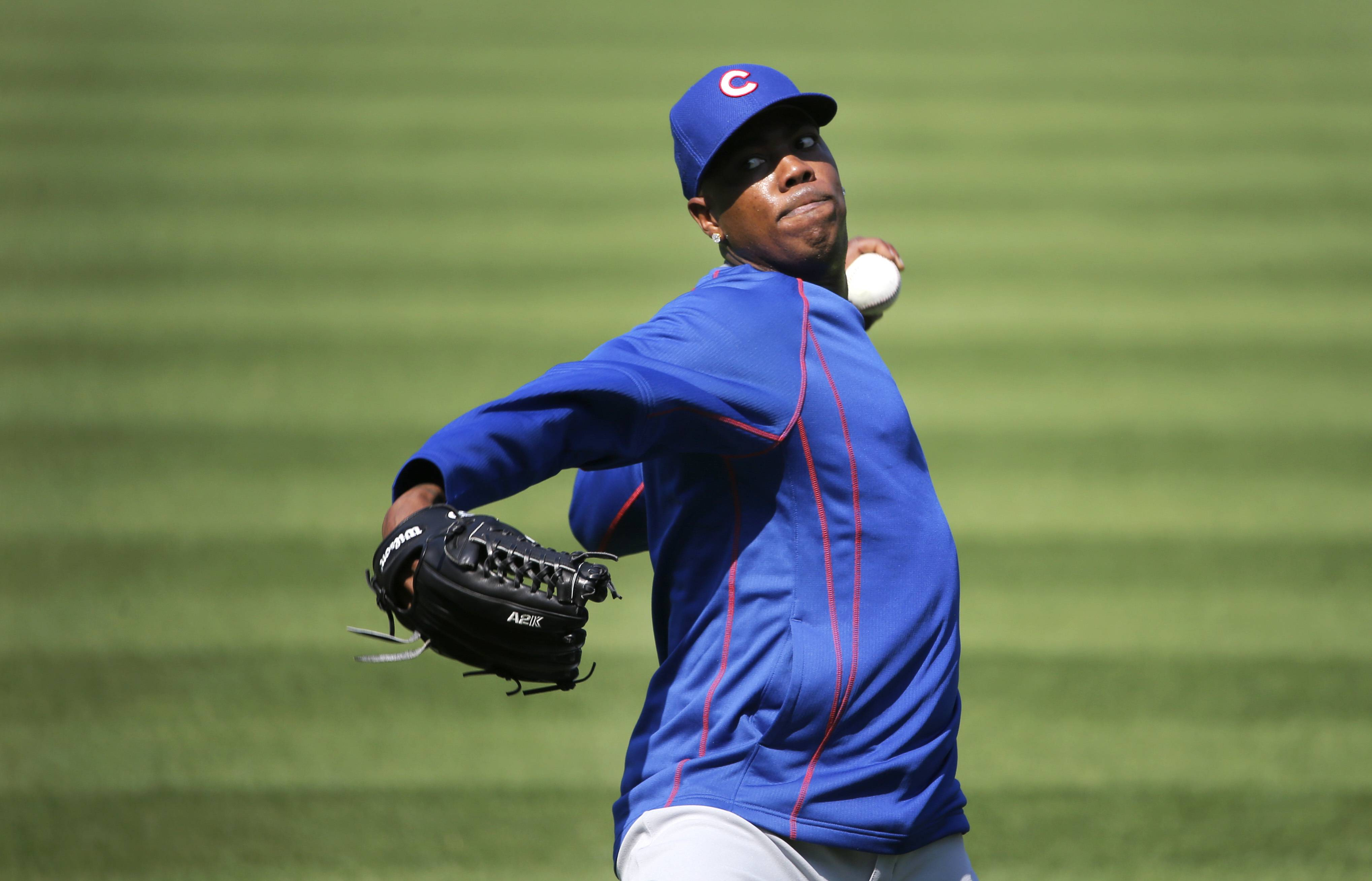 Chicago Cubs reliever Aroldis Chapman works out before a baseball game between the Cubs and Chicago White Sox Tuesday, July 26, 2016, in Chicago. (AP Photo/Charles Rex Arbogast)