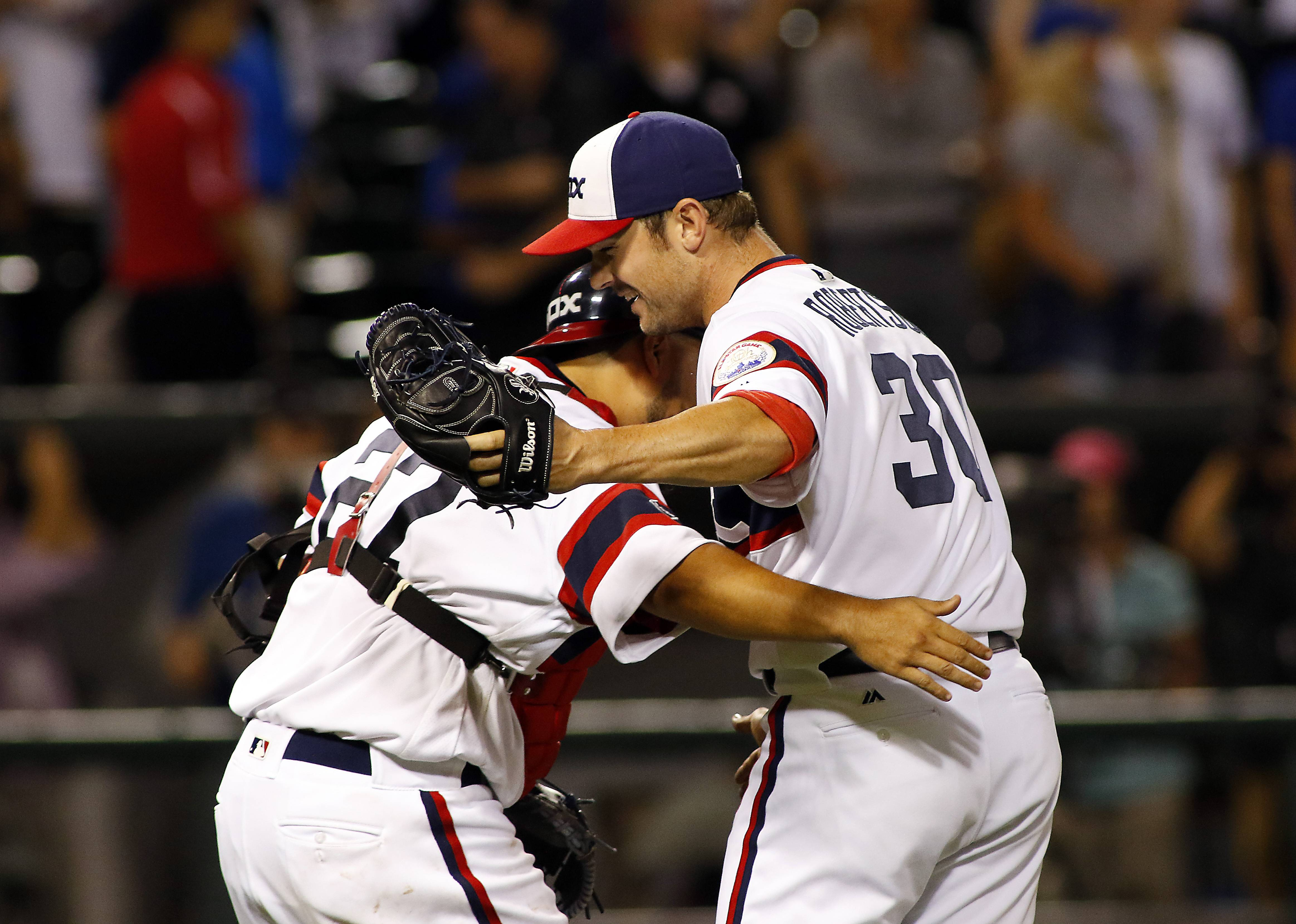 Chicago White Sox relief pitcher David Robertson (30) and catcher Dioner Navarro (27) celebrate after their victory.