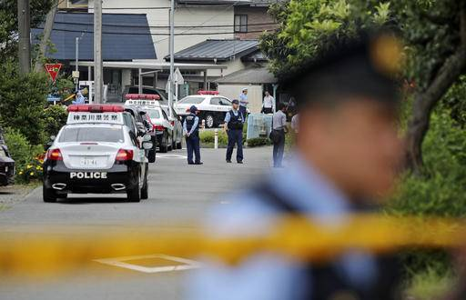 Police officers stand guard at a crossroad near the Tsukui Yamayuri-en, a facility for the mentally disabled where a number of people were killed and dozens injured in a knife attack in Sagamihara, outside of Tokyo, Japan, Tuesday, July 26, 2016. A young Japanese man went on a stabbing rampage Tuesday at the facility where he had been fired, officials said, killing many people months after he gave a letter to Parliament outlining the bloody plan and saying all disabled people should be put to death. (AP Photo/Eugene Hoshiko)