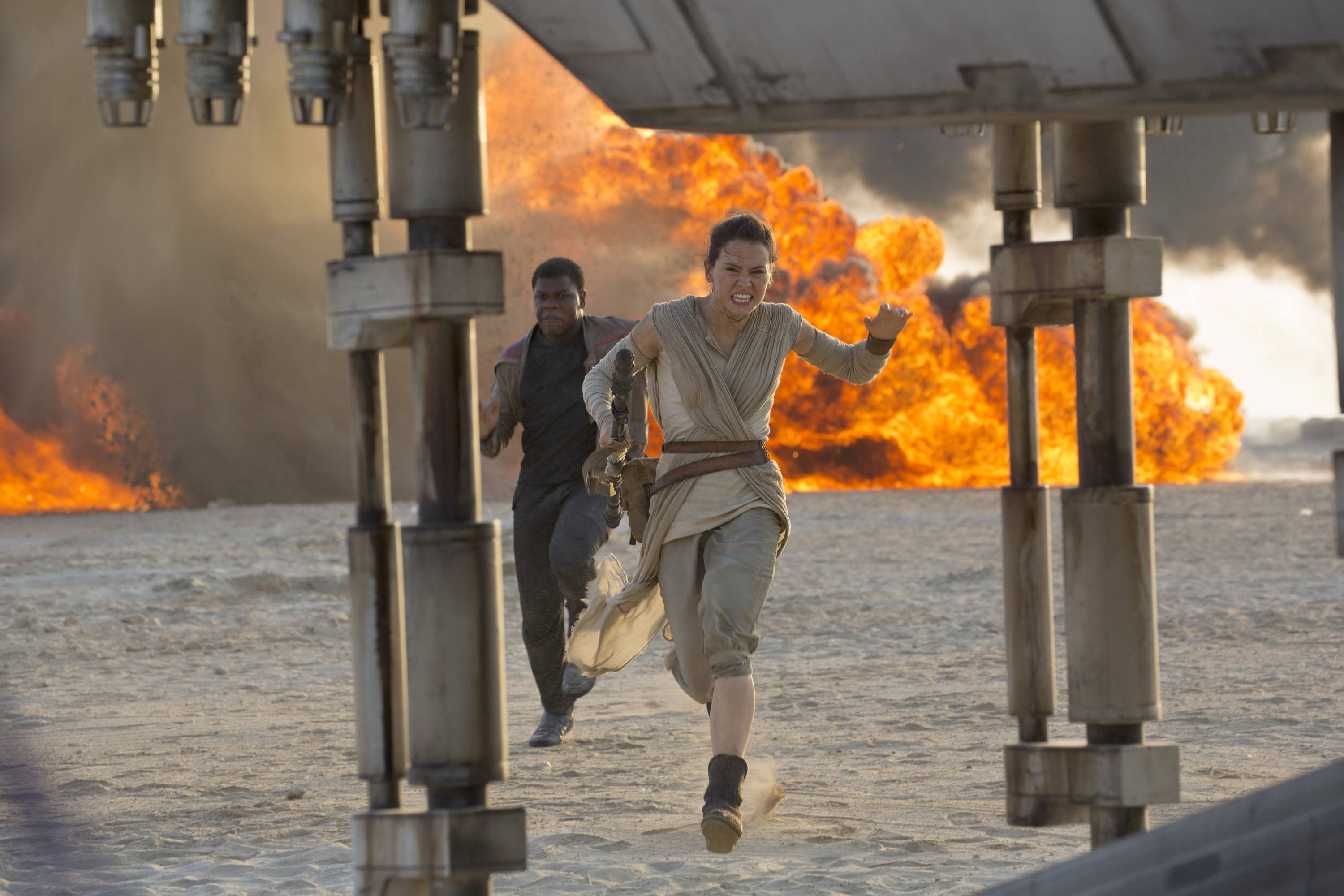 "Daisy Ridley, right, as Rey, and John Boyega as Finn, in a scene from ""Star Wars: The Force Awakens."" The J.J. Abrams-directed movie is screened at College of DuPage's Lakeside Pavilion in Glen Ellyn on Thursday, July 28."