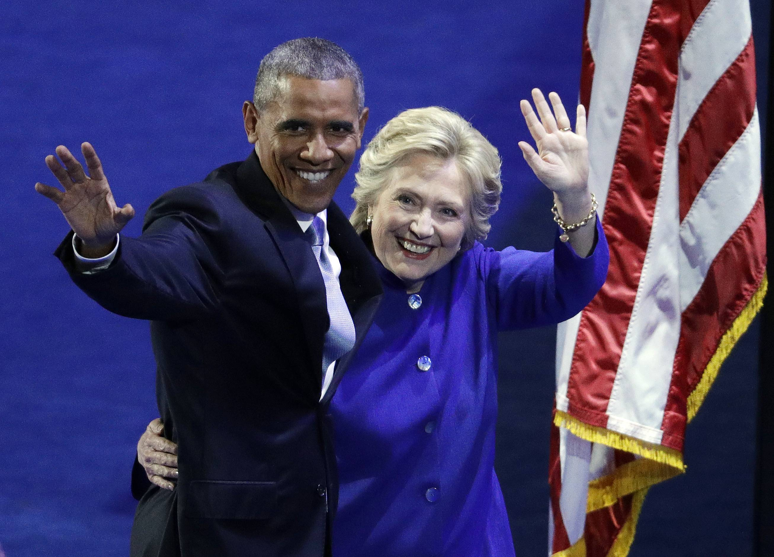 President Barack Obama and Democratic presidential candidate Hillary Clinton wave to the crowd during the third day of the Democratic National Convention, Wednesday, July 27, 2016, in Philadelphia.