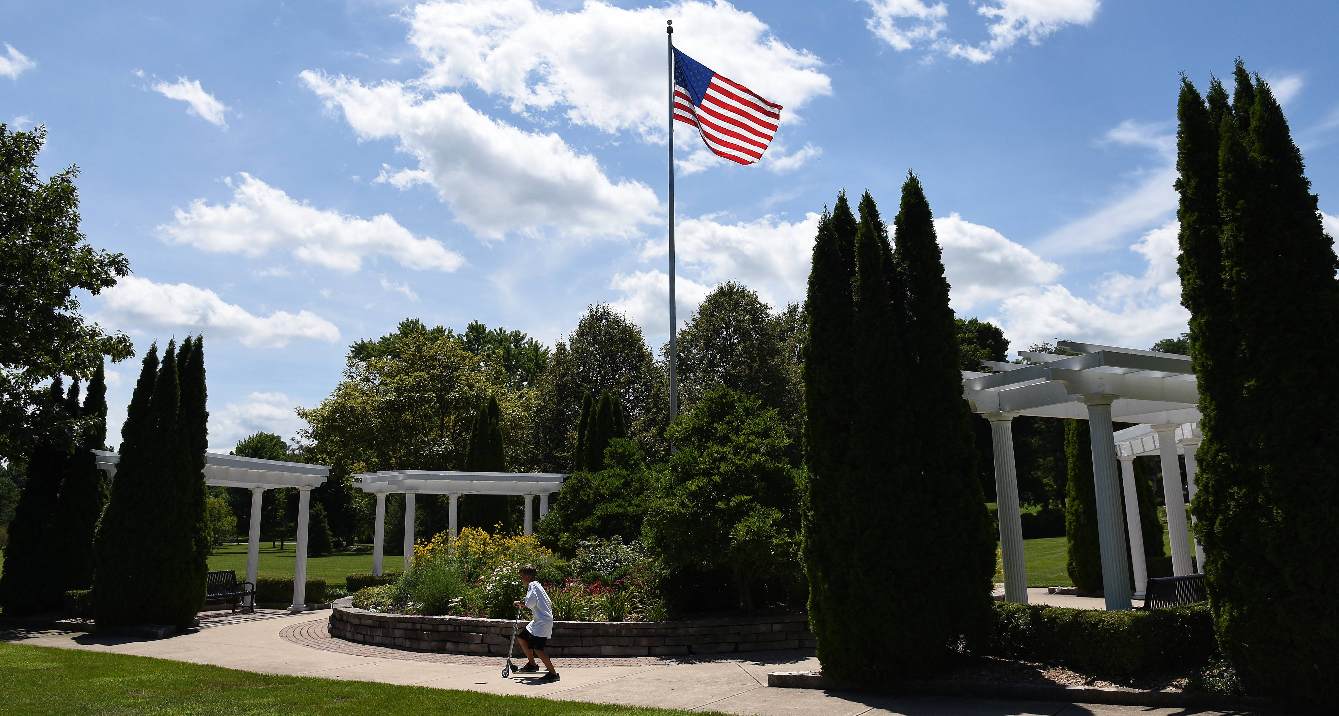 Benches and some shade afford a nice view of the American flag at Mount Saint Mary Park in St. Charles.