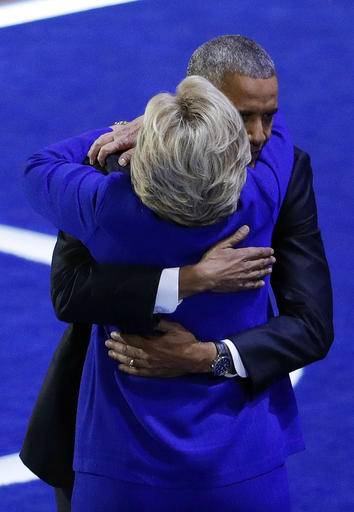President Barack Obama embraces Democratic presidential candidate Hillary Clinton during the third day of the Democratic National Convention, Wednesday, July 27, 2016, in Philadelphia.