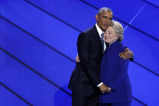 Democratic Presidential nominee Hillary Clinton hugs President Barack Obama after joining him on stage during the third day of the Democratic National Convention in Philadelphia , Wednesday, July 27, 2016.