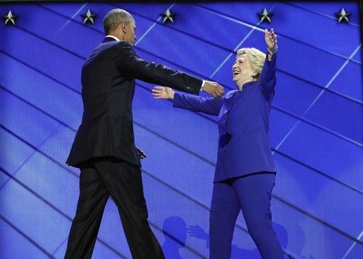 President Barack Obama hugs Democratic Presidential candidate Hillary Clinton after addressing the delegates during the third day session of the Democratic National Convention in Philadelphia, Wednesday, July 27, 2016.