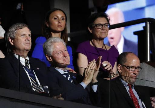 Former President Bill Clinton applauds while Vice President Joe Biden speaks during the third day of the Democratic National Convention in Philadelphia , Wednesday, July 27, 2016.