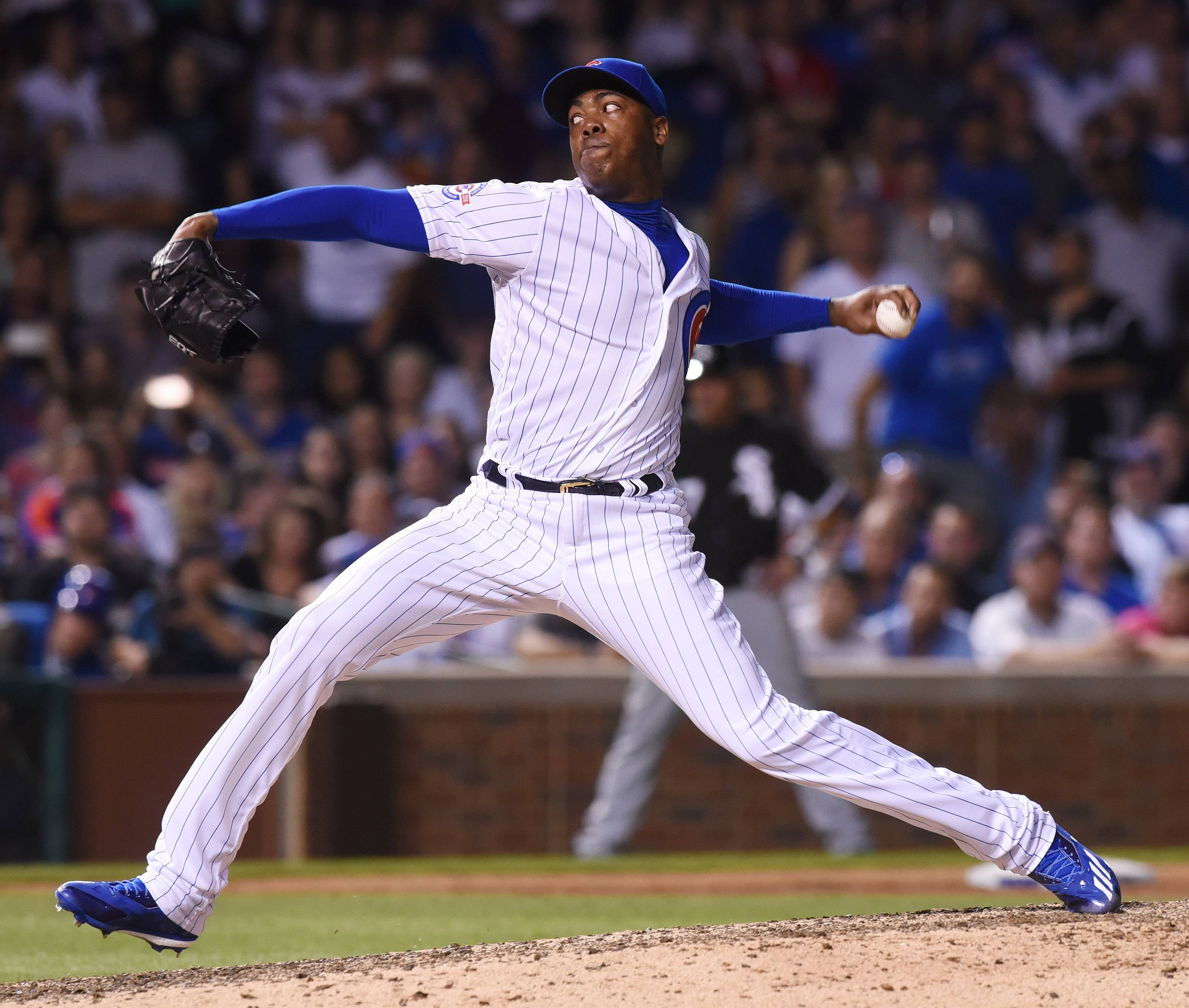 Joe Lewnard/jlewnard@dailyherald.comNew closer Aroldis Chapman makes his delivery in his Cubs debut, which was a non-save situation, during Wednesday's 8-1 victory over the White Sox at Wrigley Field in Chicago.