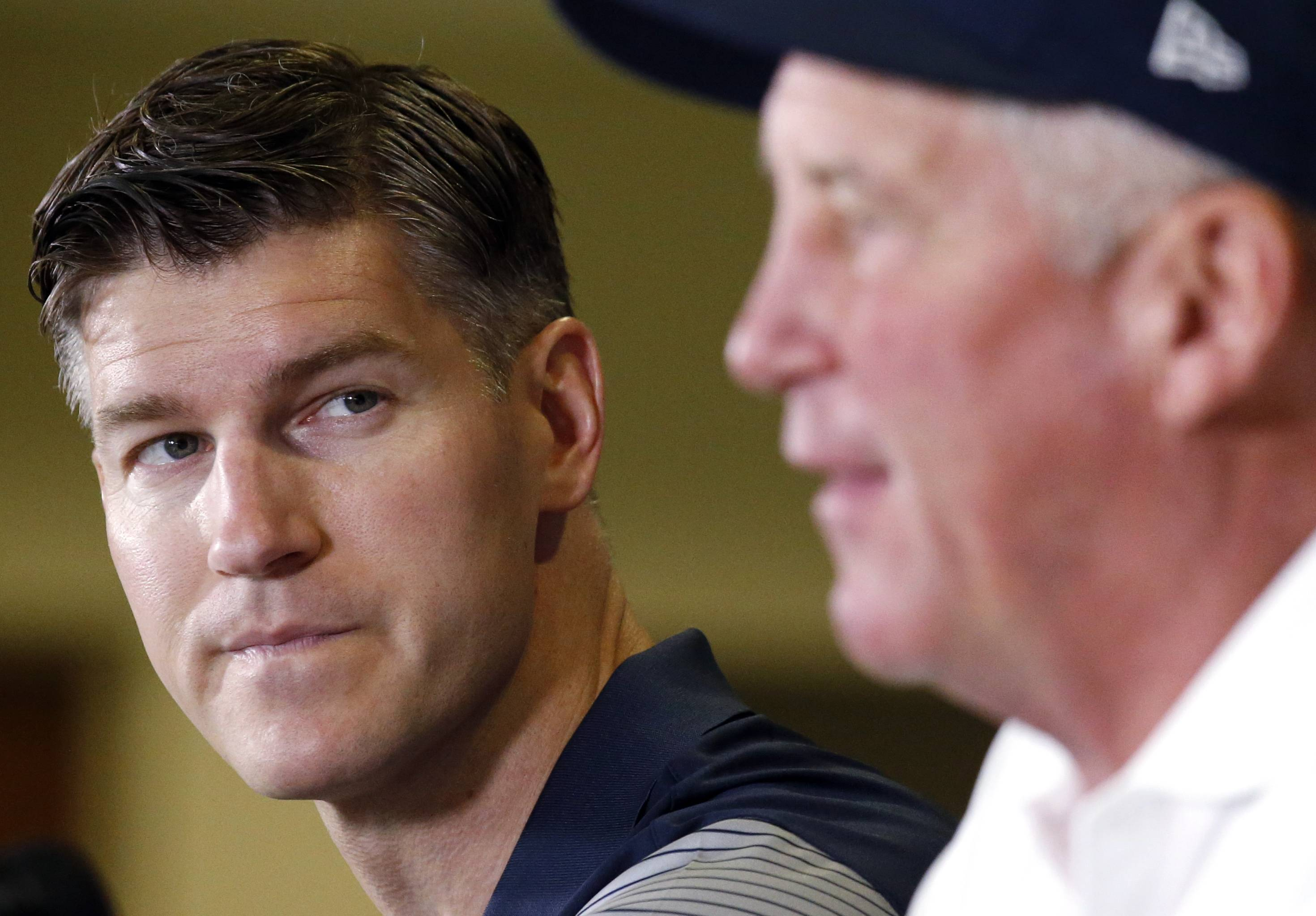 Chicago Bears general manager Ryan Pace, left, looks to head coach John Fox, right, as John Fox speaks at a news conference during team's NFL football training camp at Olivet Nazarene University, Wednesday, July 27, 2016, in Bourbonnais, Ill. (AP Photo/Nam Y. Huh)