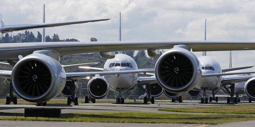 FILE - In this Friday, July 15, 2016, file photo, Boeing 7-series passenger airplanes sit parked in a lineup formation during an event marking the 100th Anniversary of the Boeing Co., in Seattle. On Wednesday, July 27, 2016, Boeing reports financial results. (AP Photo/Ted S. Warren, File)