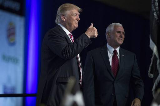 Republican presidential candidate Donald Trump and his running mate, Republican Vice Presidential candidate, Indiana Gov. Mike Pence, arrive for the Veterans of Foreign Wars convention, Tuesday, July 26, 2016, in Charlotte, N.C. (AP Photo/Evan Vucci)