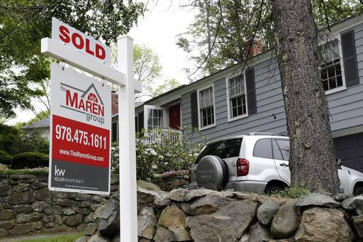 "FILE - This Tuesday, May 24, 2016, file photo shows a ""Sold"" sign in front of a house in Andover, Mass. On Wednesday, July 27, the National Association of Realtors releases its June report on pending home sales, which are seen as a barometer of future purchases. (AP Photo/Elise Amendola, File)"