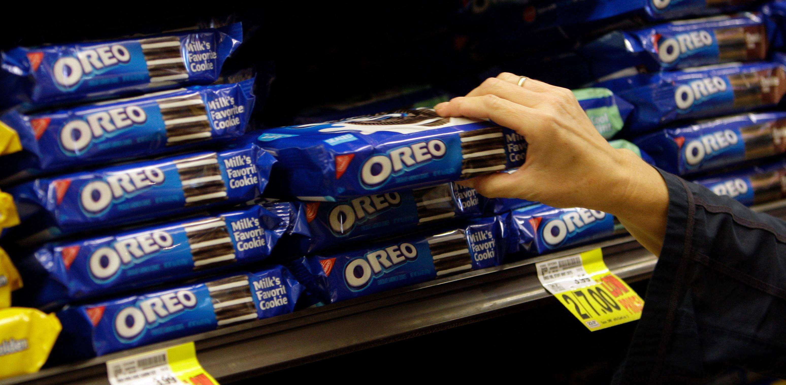 Deerfield-based Mondelez International, the global snack giant whose brands include Oreo cookies, posted second-quarter earnings that beat estimates after cost cuts helped offset sluggish sales.