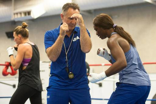 FILE - In this Friday, July 15, 2016, file photo, Claressa Shields, right, trains with women's Olympic team coach Billy Walsh at the U.S. Olympic Training Center Colorado Springs, Colo. Coach Billy Walsh brought a lifetime of amateur boxing experience from his native Ireland when he took over at foundering USA Boxing late last year. When he tried to impose that knowledge on Olympic gold medalist Claressa Shields, they nearly tore apart the program before finding mutual respect on their way to Rio de Janeiro.(Ryan Jones/The Gazette via AP, File)