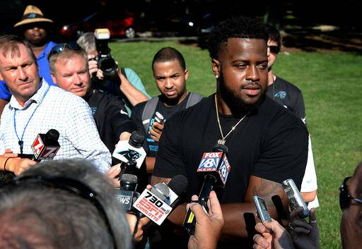 Carolina Panthers defensive tackle Kawann Short, right, answers questions from the media after moving into the dorm at Wofford College in Spartanburg, SC on Wednesday, July 27, 2016. (Jeff Siner/The Charlotte Observer via AP)