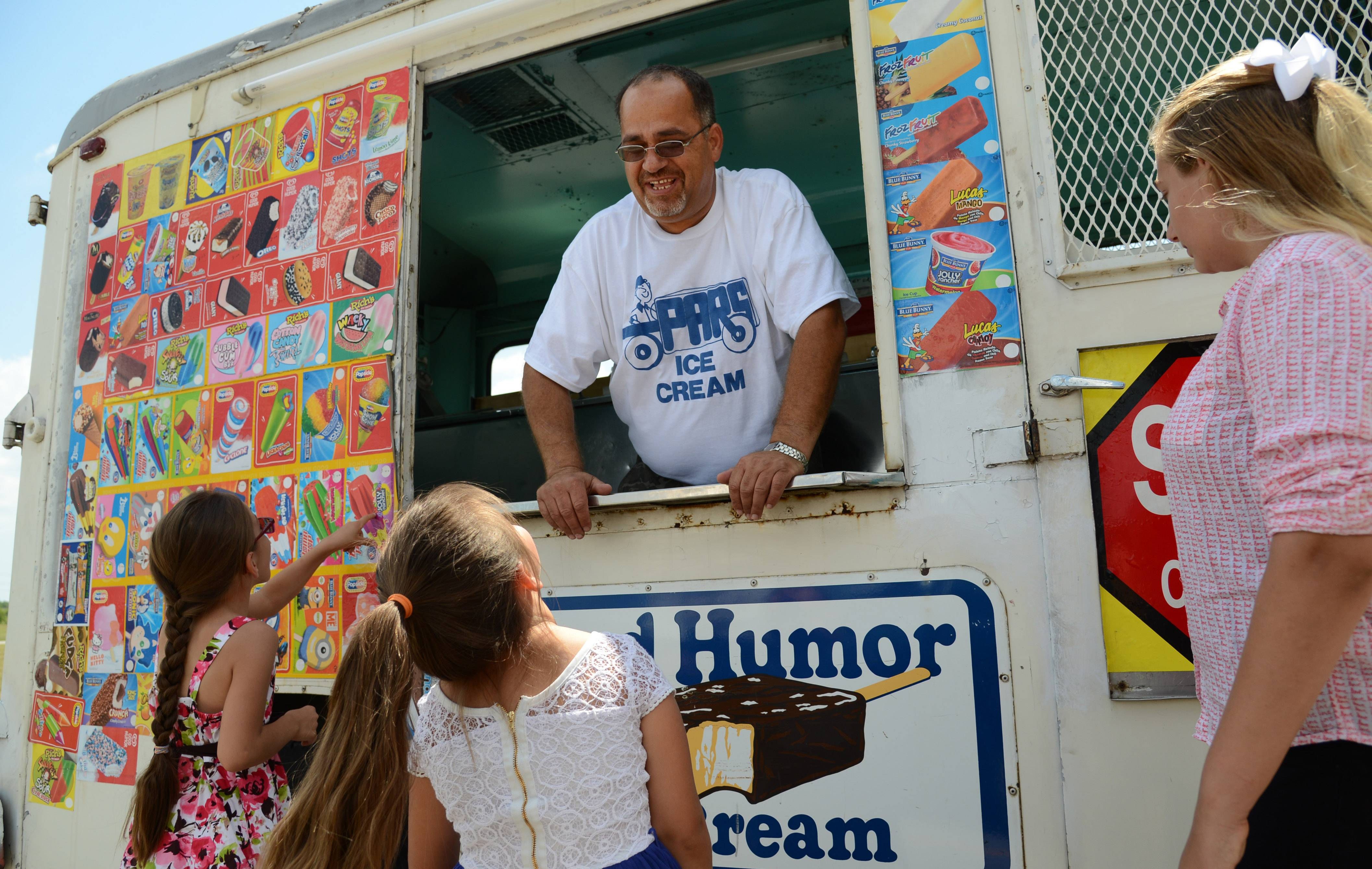 Mundelein officially ended a decades-old prohibition on ice cream trucks. One vendor, Abdalla Alassuli, is cruising the Mundelein streets selling his products.
