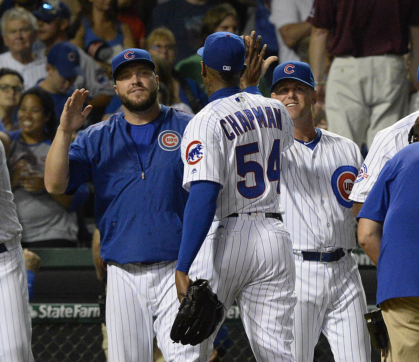 Chicago Cubs pitcher Aroldis Chapman delivers the high-fives after the Cubs beat the Chicago White Sox at Wrigley Field.
