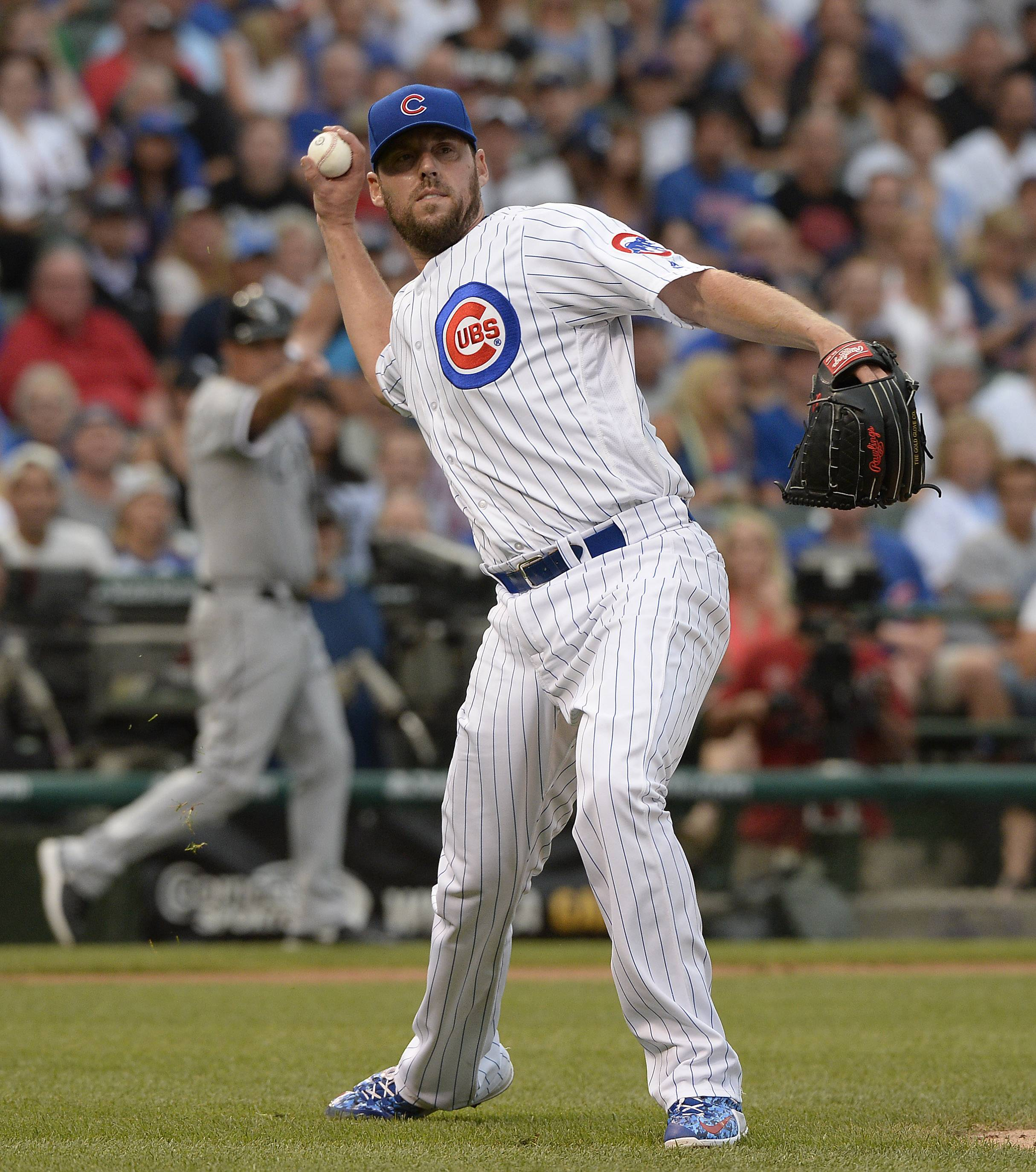 Mark Welsh/mwelsh@dailyherald.comChicago Cubs pitcher John Lackey throws to first in the first inning against the Chicago White Sox at Wrigley Field.