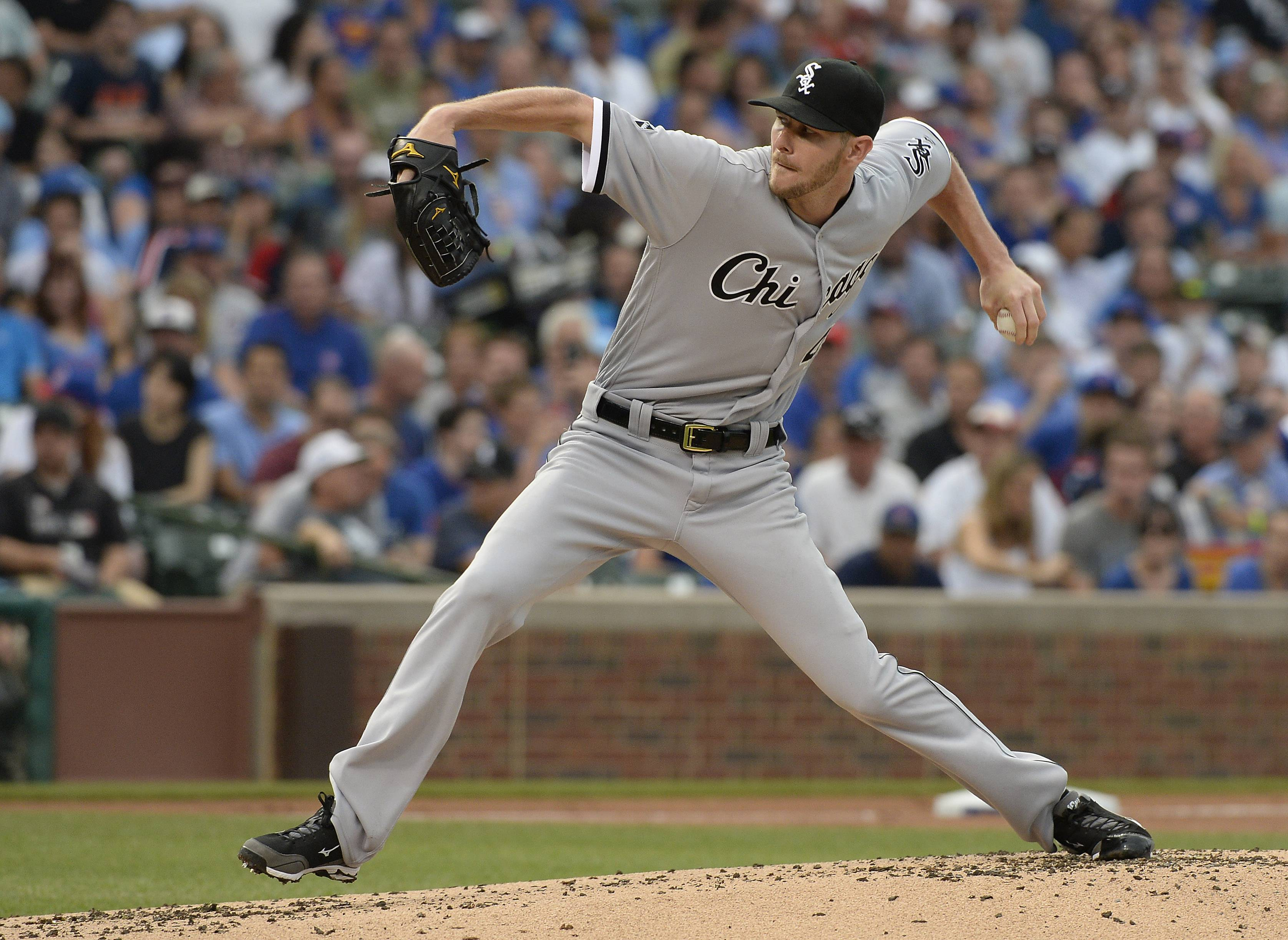 Mark Welsh/mwelsh@dailyherald.comWhite Sox pitcher Chris Sale fires his pitch in the first inning against the Chicago Cubs at Wrigley Field on Thursday.