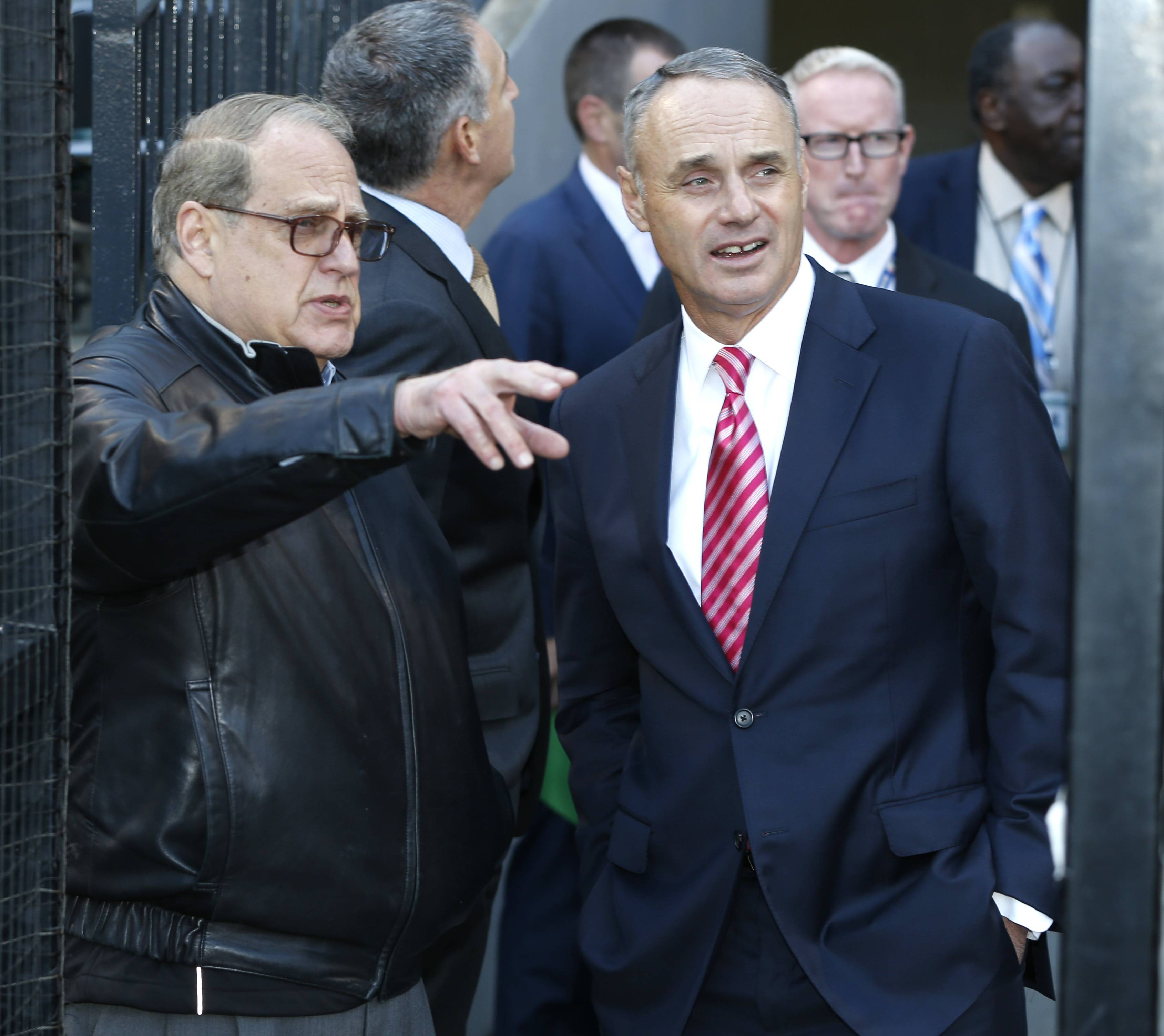 Chicago White Sox chairman Jerry Reinsdorf, left, talks with Major league Baseball commissioner Rob Manfred before a baseball game between the White Sox and the Boston Red Sox Thursday, May 5, 2016, in Chicago. (AP Photo/Charles Rex Arbogast)