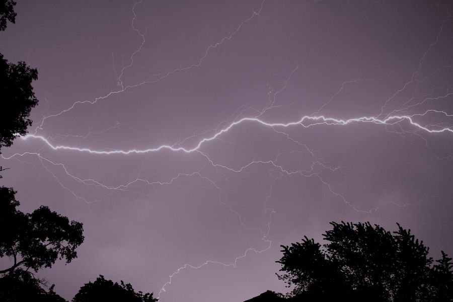A lightning bolt streaks across the nighttime sky in Rolling Meadows during a storm.