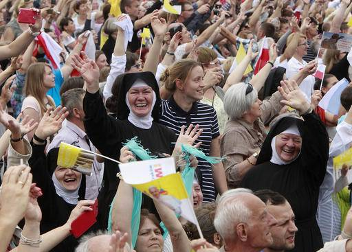Pope Francis talks from the Archbishops' Palace in Krakow, Poland, Wednesday, July 27, 2016. Francis came on a five-day visit to Poland to join hundreds of thousands of young people from around the globe for celebrations of the World Youth Day. (AP Photo/Alik Keplicz)