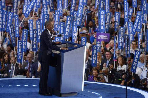 President Barack Obama smiles as he steps to the podium during the third day of the Democratic National Convention in Philadelphia , Thursday, July 28, 2016. (AP Photo/Mark J. Terrill)