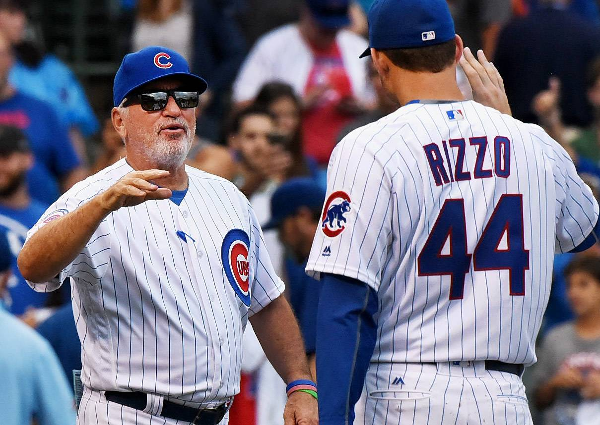 Bob Chwedyk/bchwedyk@dailyherald.comChicago Cubs manager Joe Maddon (70) congratulates Chicago Cubs first baseman Anthony Rizzo (44) after a 12-1 victory over the Seattle Mariners.
