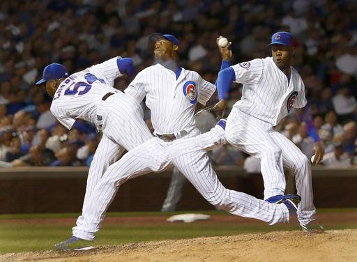Chicago Cubs relief pitcher Aroldis Chapman delivers in this multiple exposure photo during the ninth inning of a baseball game against the Chicago White Sox on Thursday, July 28, 2016, in Chicago. Chapman recorded his first save as a Cubs beat the Chicago White Sox 3-1. (AP Photo/Charles Rex Arbogast)
