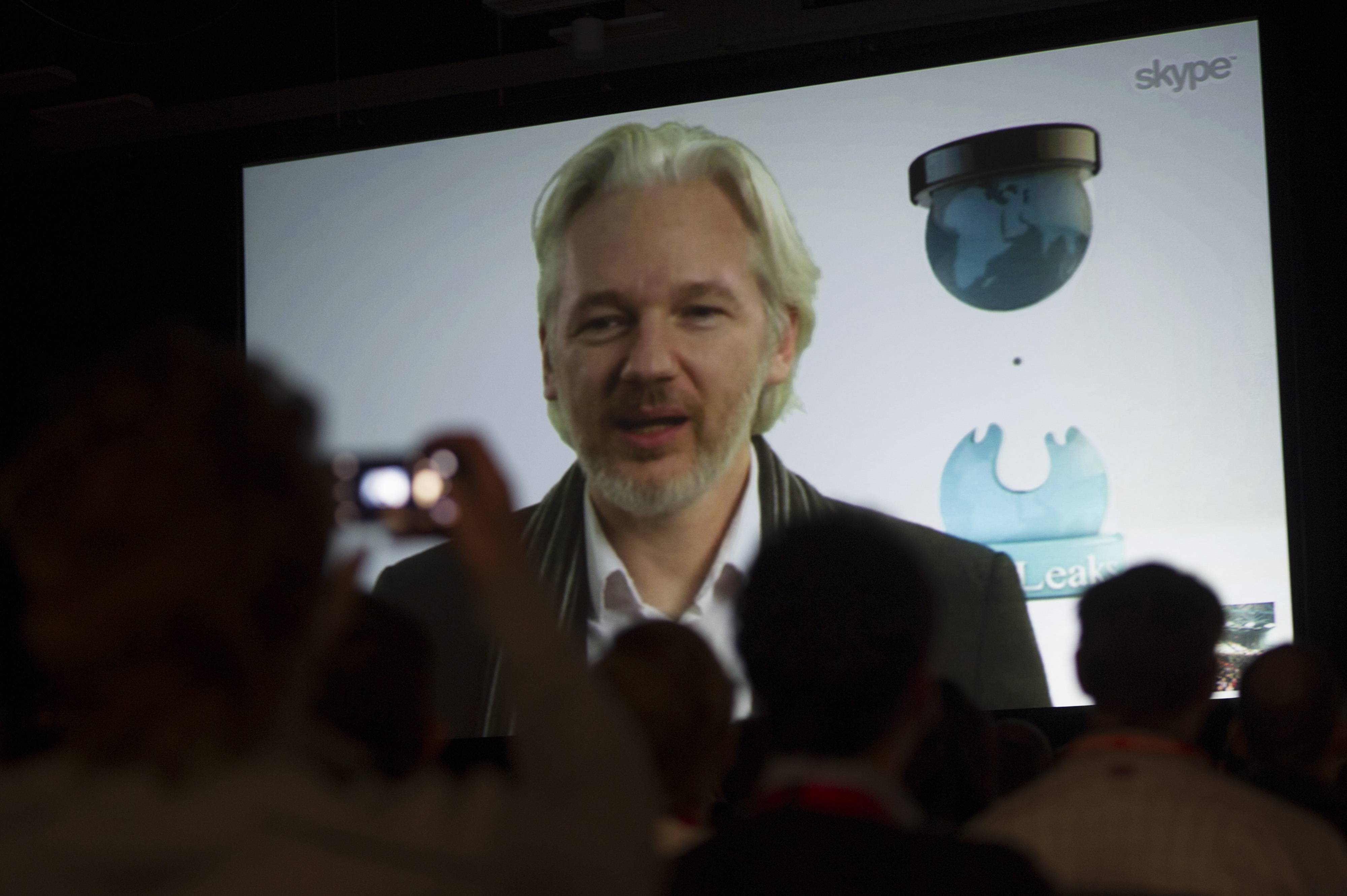 Julian Assange, founder of the WikiLeaks website, speaks during a panel discussion at the South By Southwest (SXSW) Interactive Festival in Austin, Texas, U.S., on March 8, 2014.