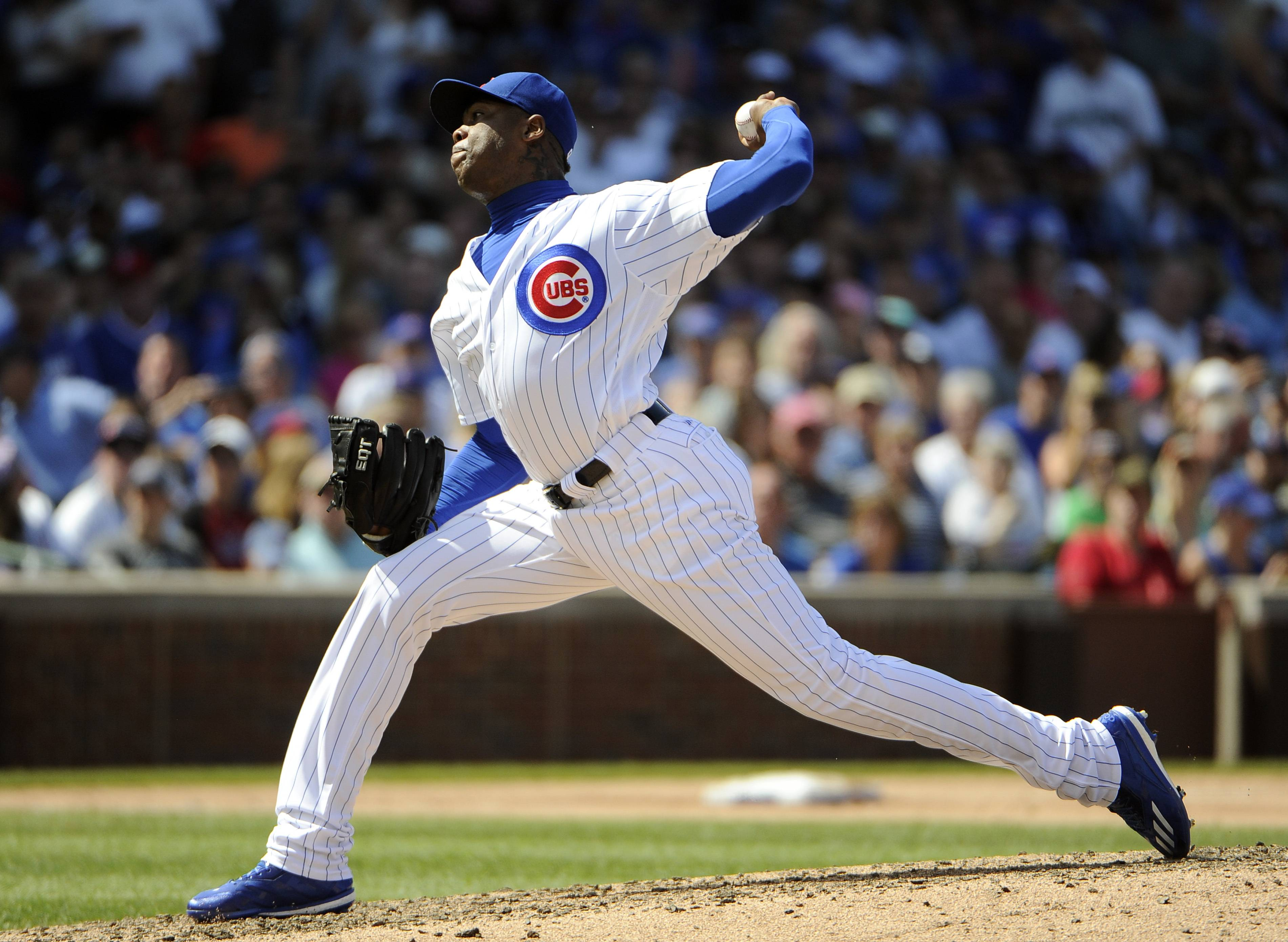 Cubs relief pitcher Aroldis Chapman throws against Seattle during the eighth inning on Saturday in Chicago. Cub fans will embrace Chapman, and disregard his past, as long as he throws 100 mph and gets the job done, Barry Rozner says.