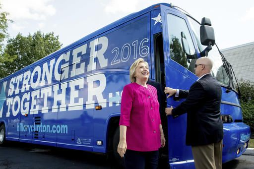 Democratic presidential candidate Hillary Clinton gets off her campaign bus as she arrives for a rally at K'NEX, a toy company in Hatfield, Pa., Friday, July 29, 2016. Clinton and Kaine begin a three day bus tour through the rust belt.