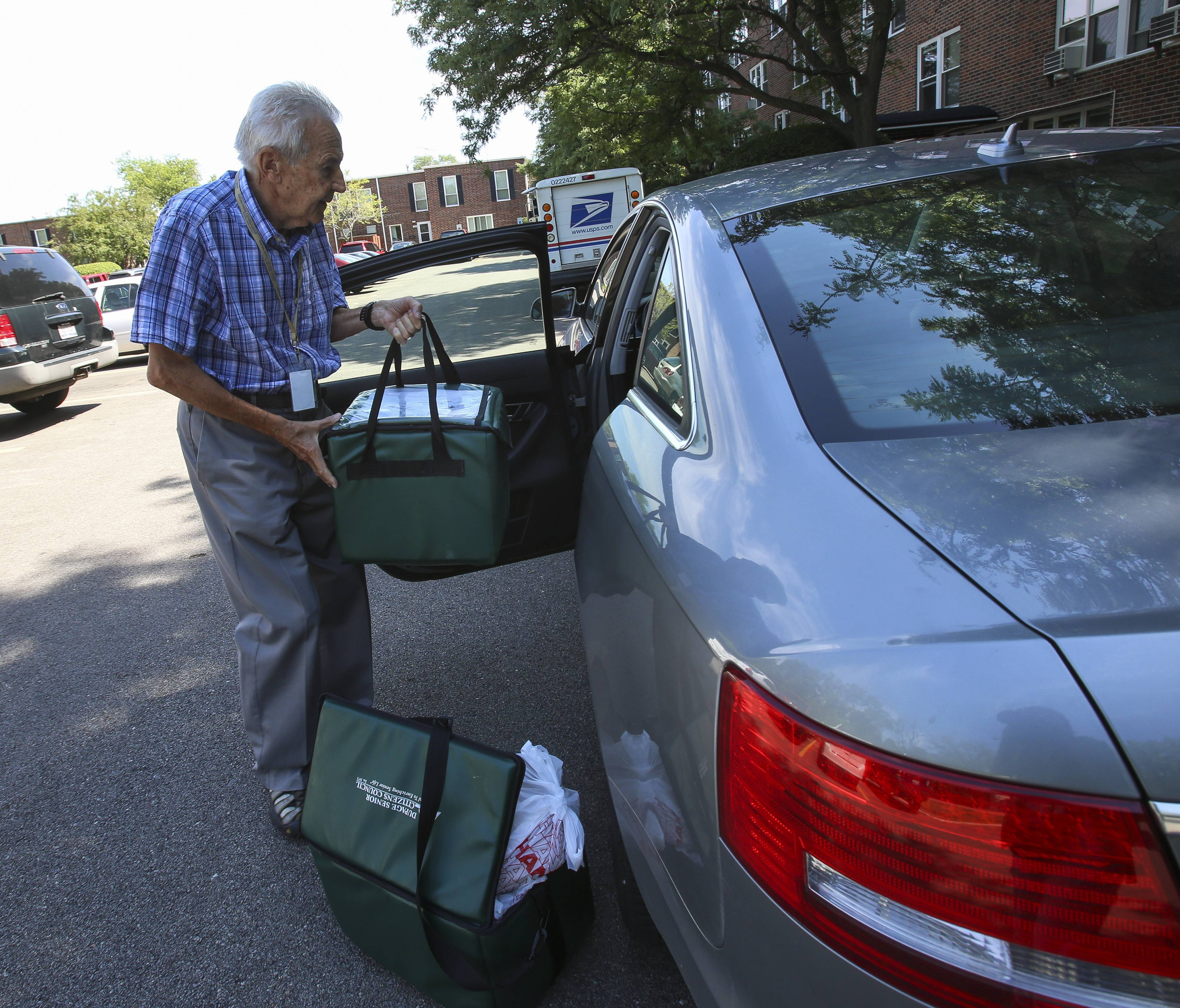 Hans Kohlmann of Winfield loads his car with meals for the DuPage Senior Citizen Council's Delivered Meal Program in Wheaton.