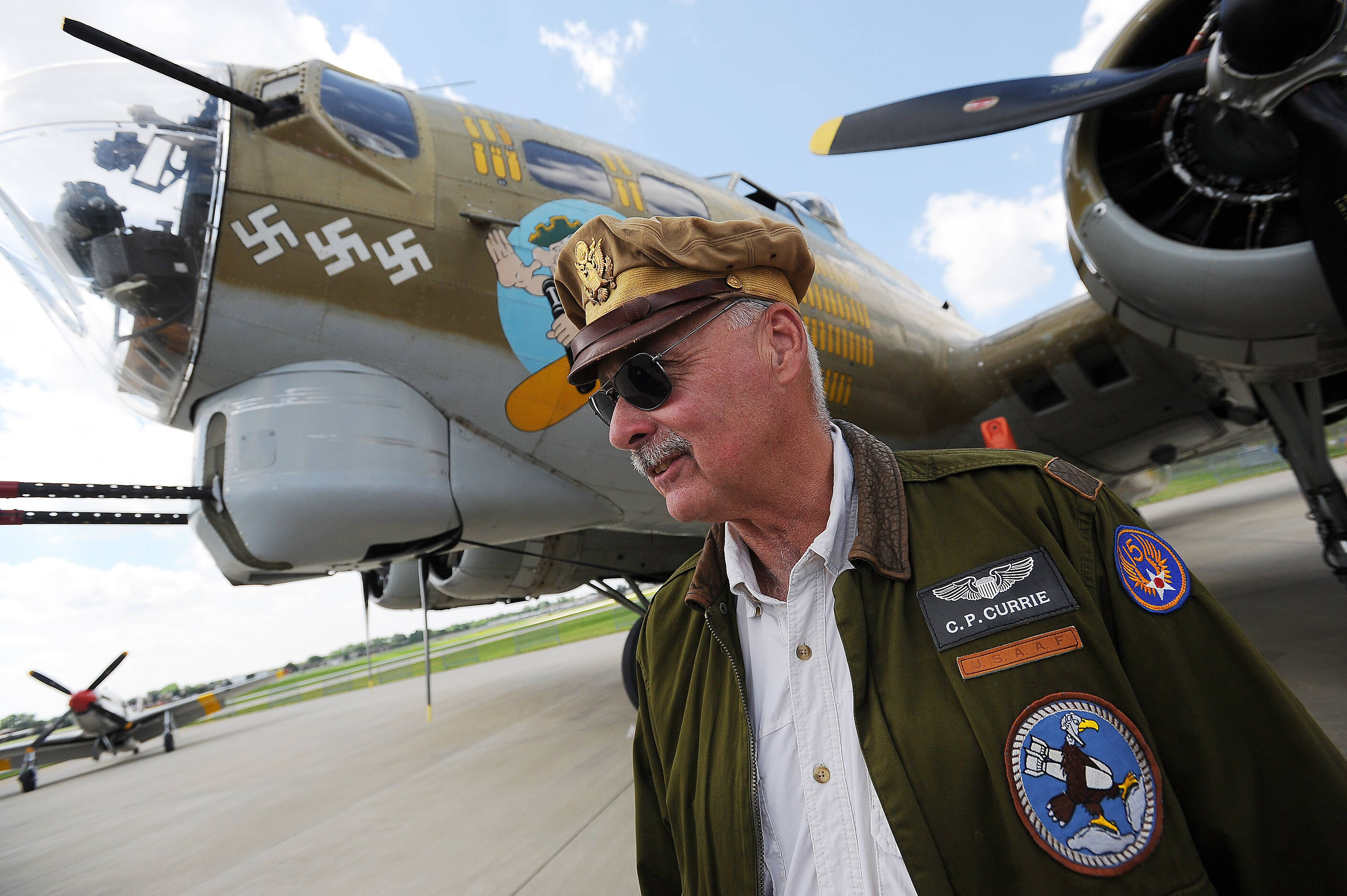 In his dad's flight jacket and hat, Chuck Currie of Prospect Heights prepares to take a spin in a vintage B-17 Flying Fortress -- giving him some idea of what it was like for his father during World War II.