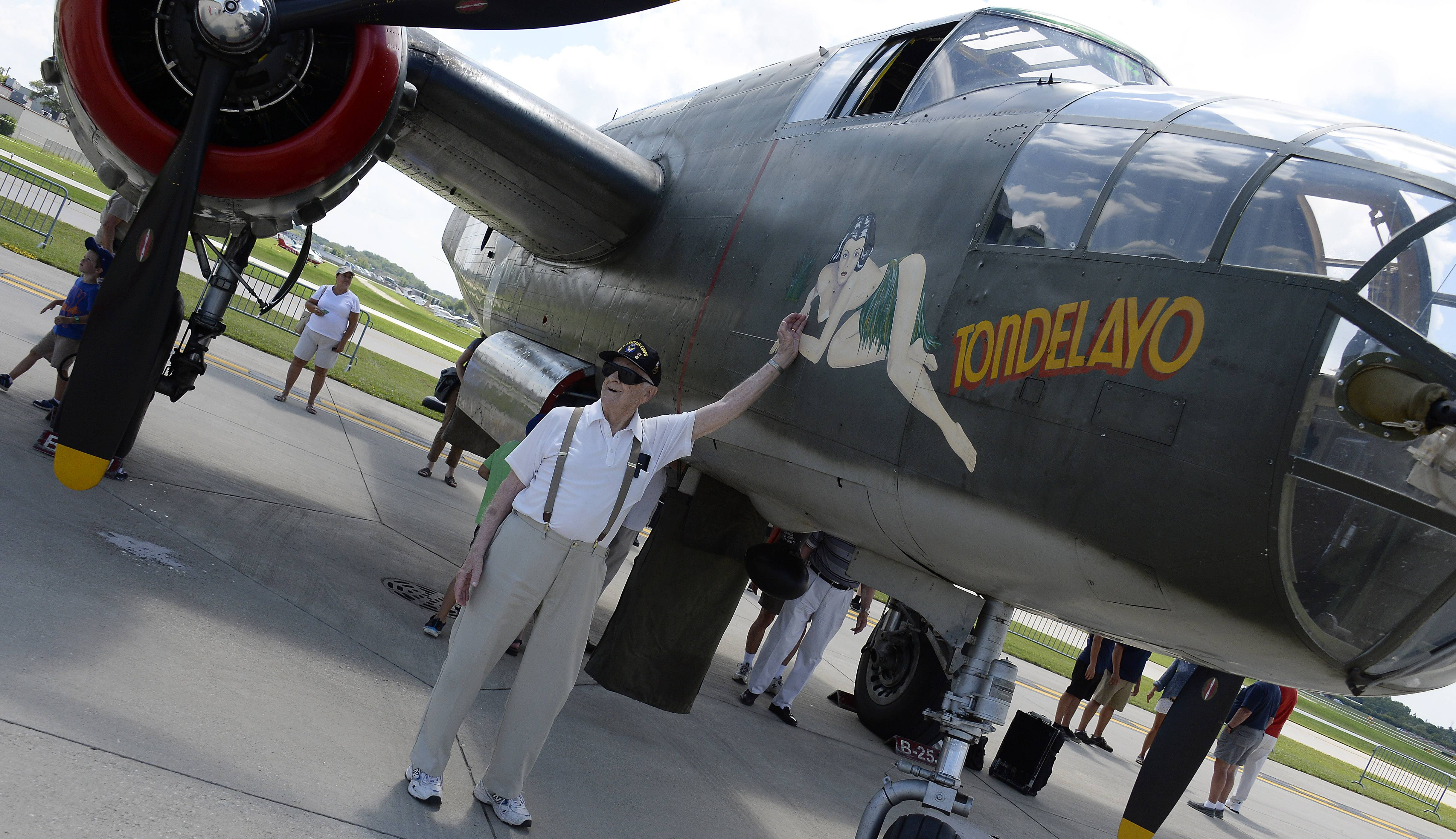 "Ken Zschach, 93, of Mount Prospect flew in a B-24 as a waist gunner during the war. Here he stands with the North American B-25 Mitchell ""Tondelayo"" bomber."