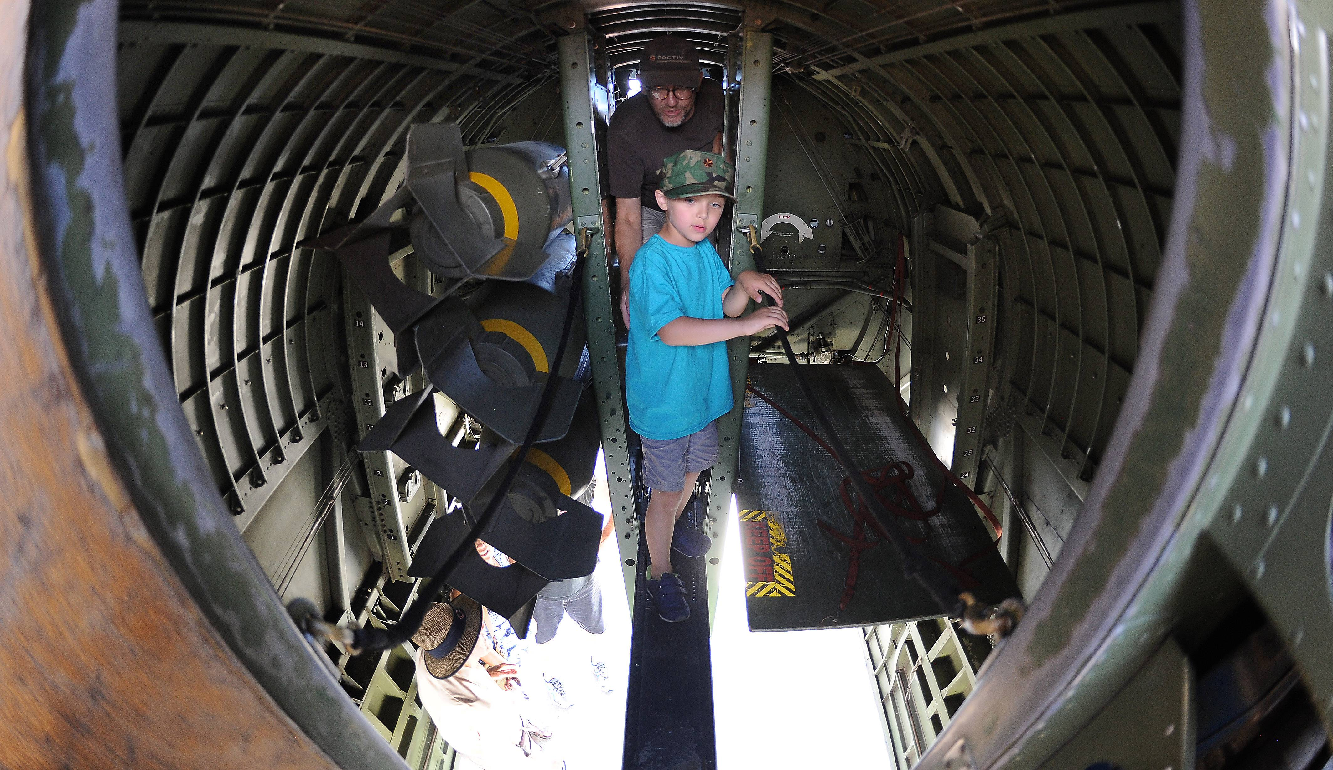 Seeing a vintage Boeing B-17 Flying Fortress was a thrill for Nathaniel Matusik, 5, and his dad, Matthew, of Morton Grove who squeezed through the bomb compartment Monday at Chicago Executive Airport in Wheeling.