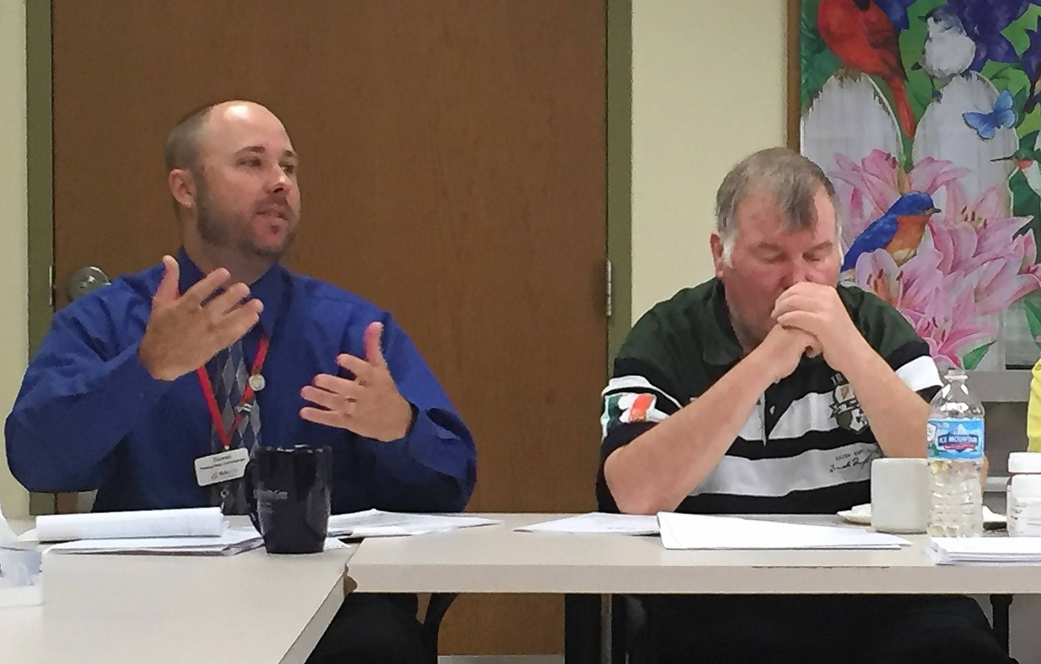 Valley Hi Administrator Thomas Annarella, left, on Wednesday discusses a scabies outbreak at the McHenry County-operated facility in Woodstock.
