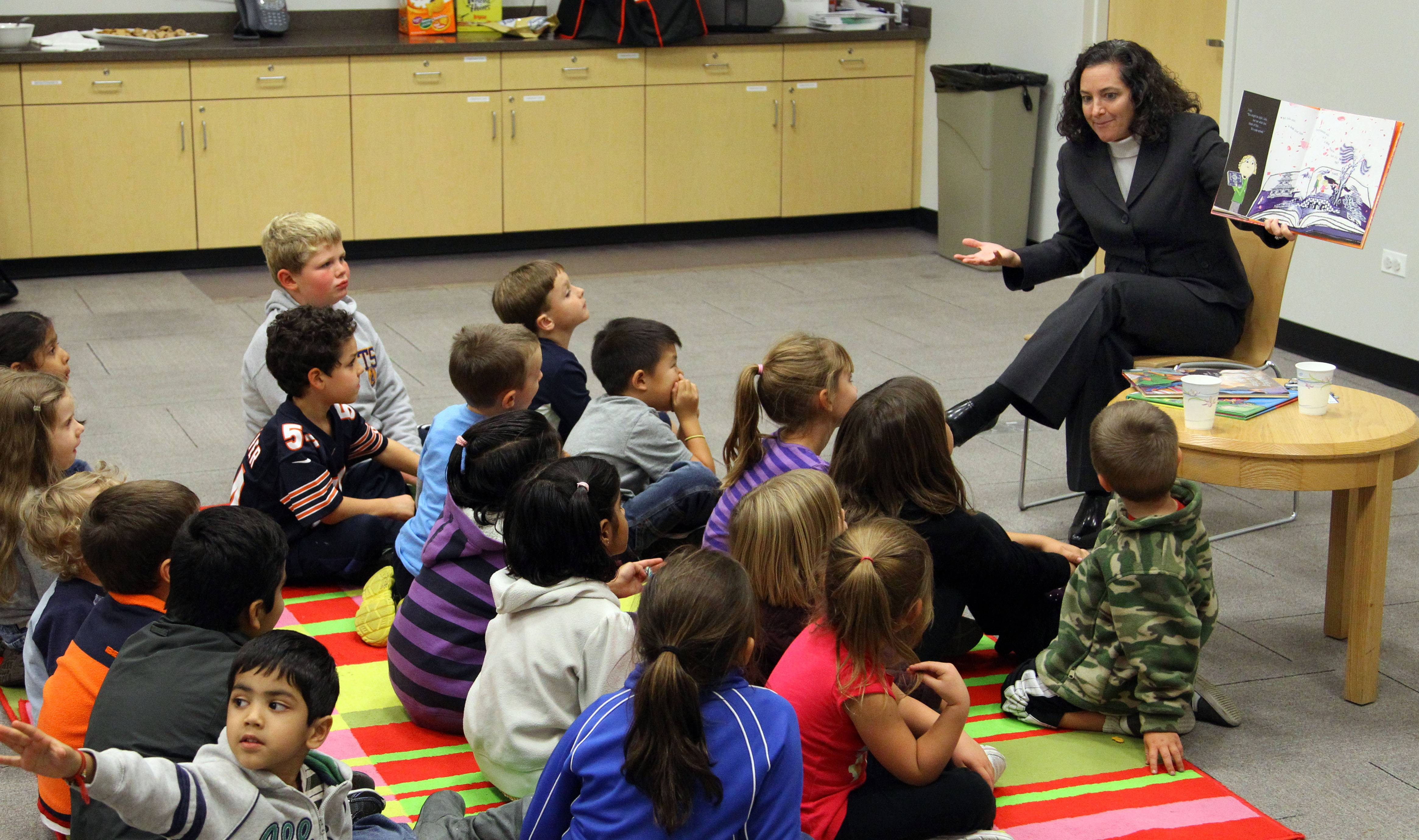 Hawthorn Elementary South Principal Jill Martin reads to students during the Principals Read program at Aspen Drive Library in Vernon Hills.