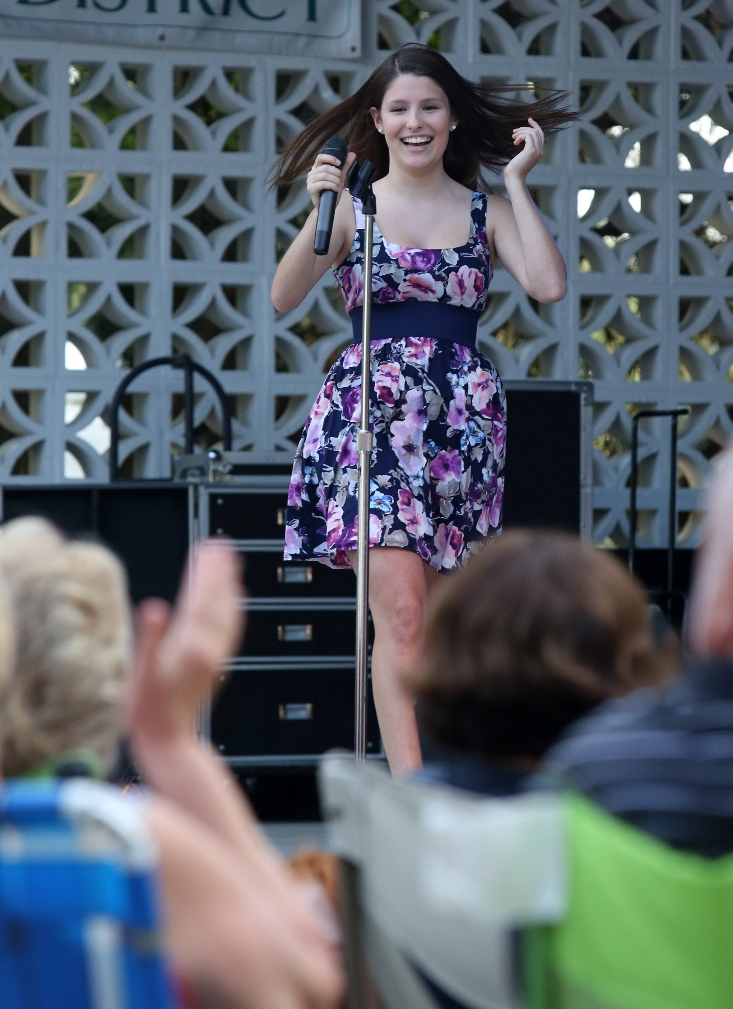 "Holly Beemer, 14, of Gurnee, gets a big hand from the crowd and encouraging words from the judges during the Gurnee Idol contest after singing Etta James' ""At Last"" at Gurnee Days."