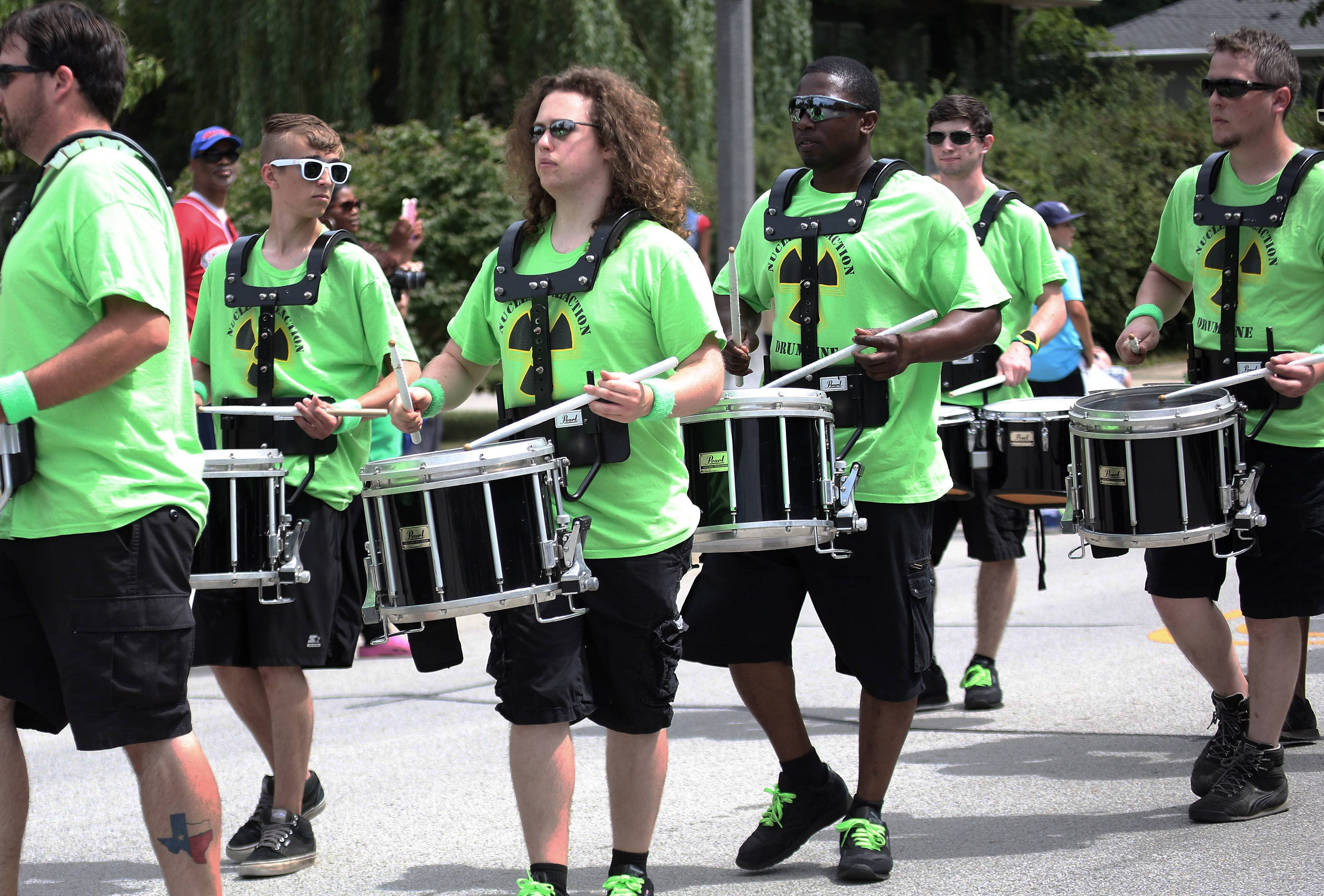 The Nuclear Reaction Drumline performs during the Gurnee Days parade along Old Grand Avenue.