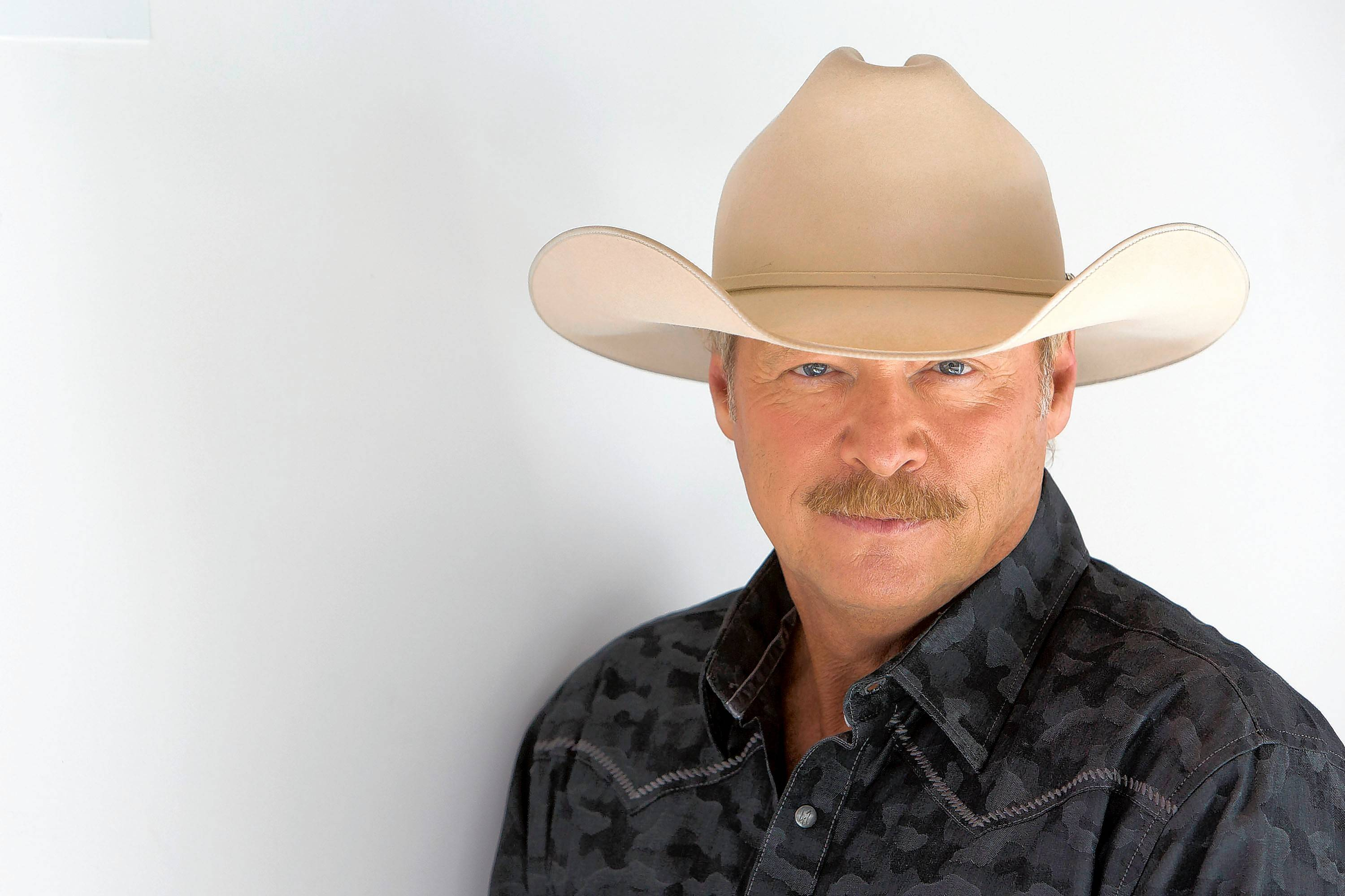 Country singer Alan Jackson performs at Aurora's RiverEdge Park Saturday.