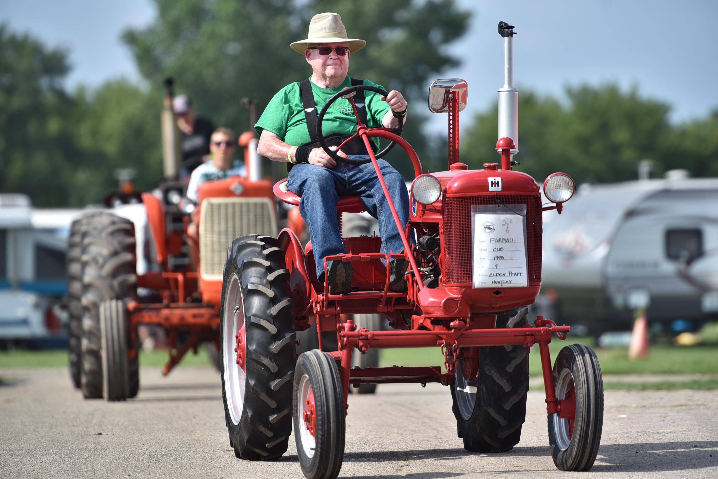 Elden Pfaff, of Huntley steers his 1948 Farmall Cub through the McHenry County Fairgrounds in Woodstock Wednesday, during a tractor parade in the 2016 fair. The small tractor produces only 9 horsepower.