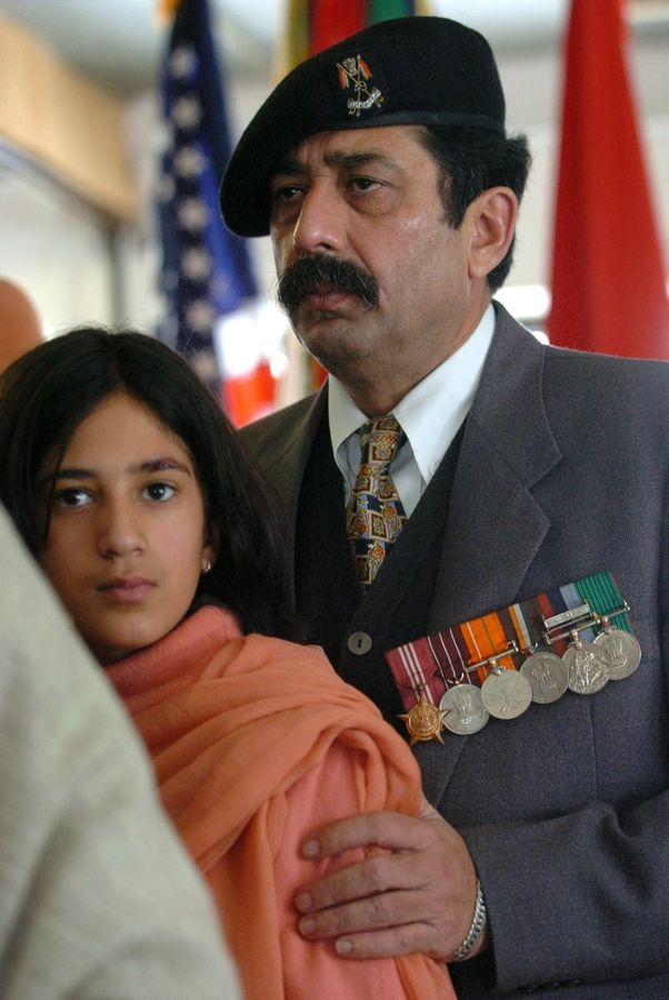 Uday Singh's father, Preet Mahinder, comforts daughter Bani Kaur, 10, during a memorial service for Singh in 2004 in Palatine.