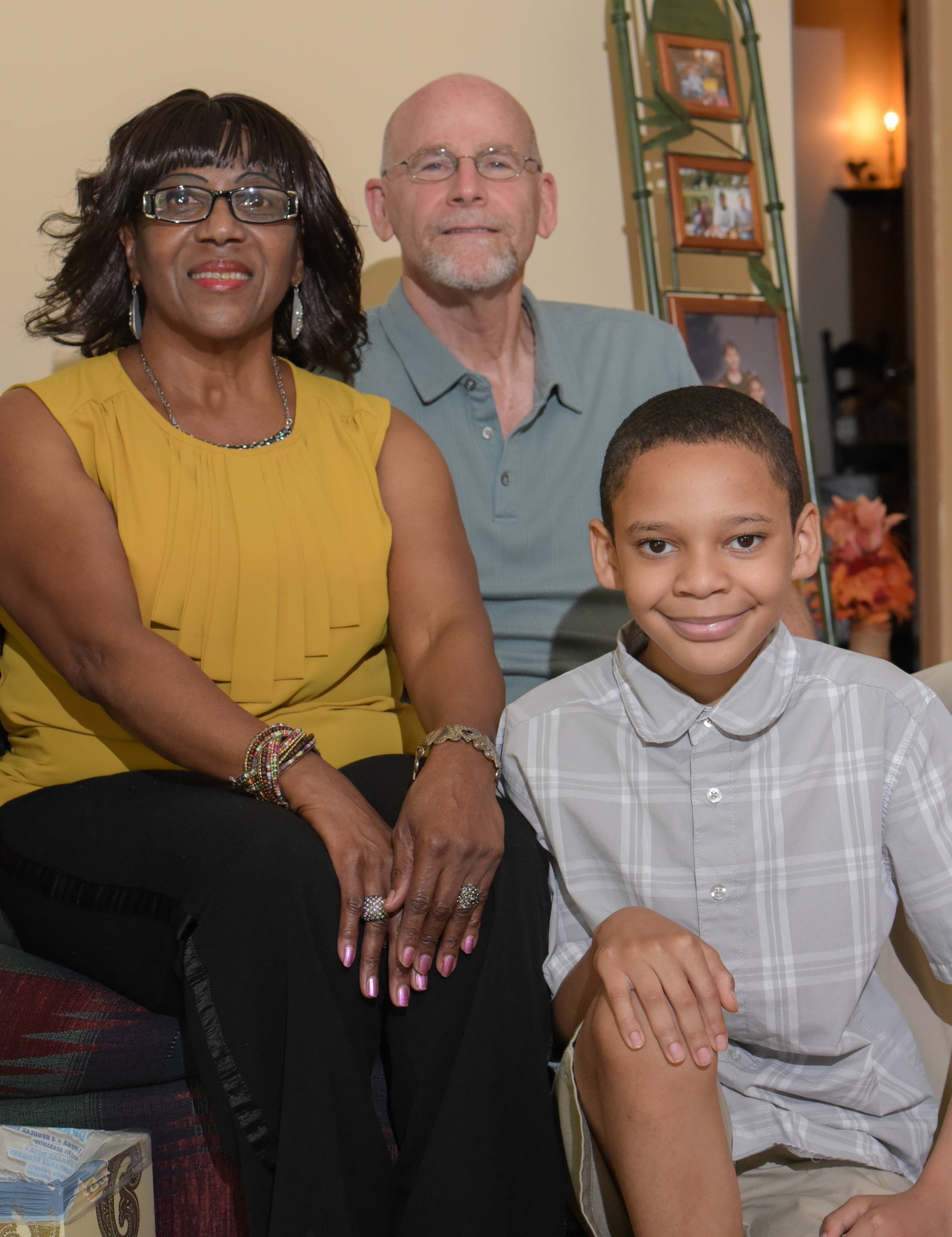 Neil Samuels of Naperville served as a mentor to Jearline Gatlin of Naperville and helped her learn skills to parent her 11-year-old grandson, Jalen.