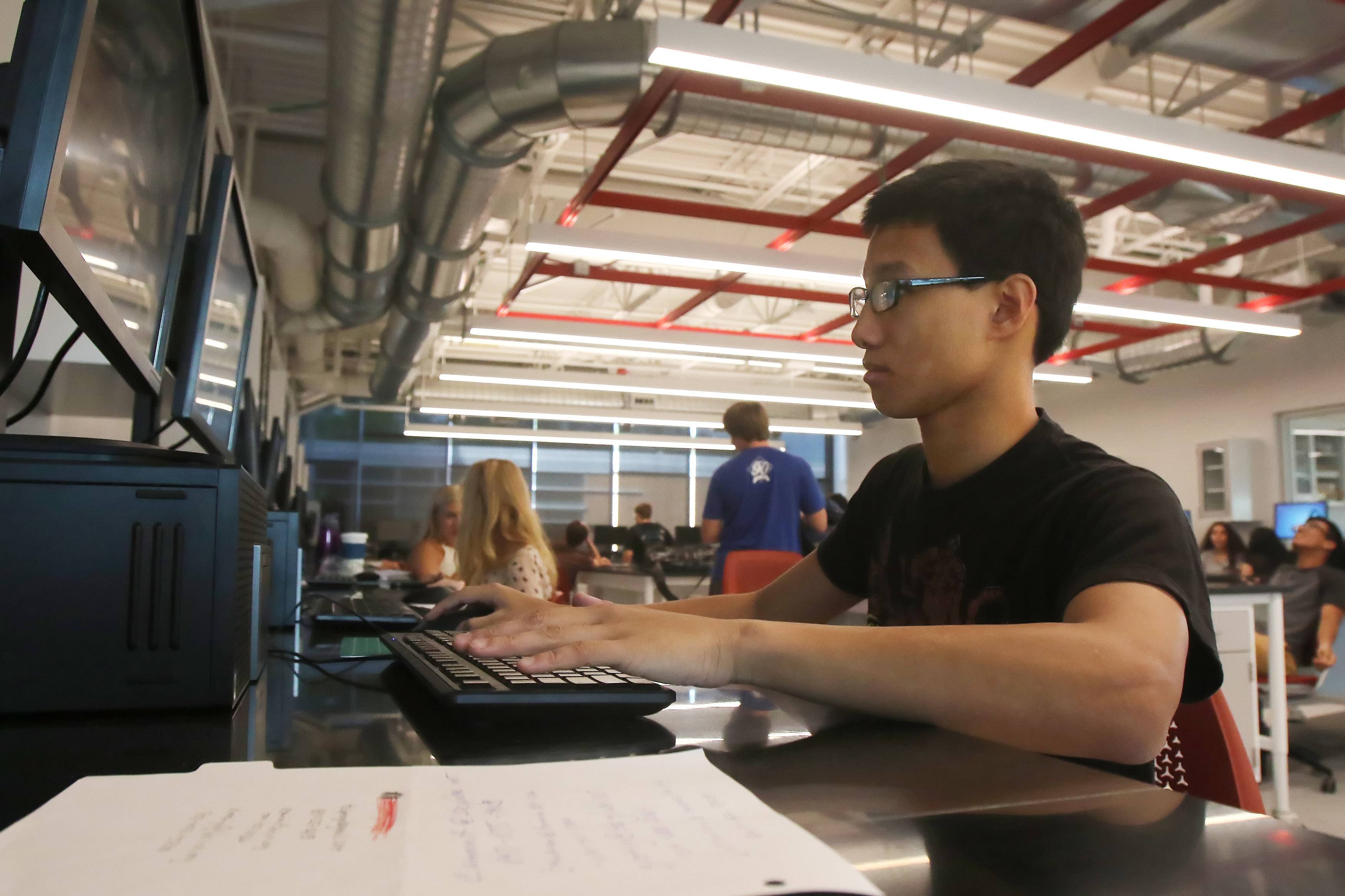 Senior Joseph Leong works on a computer in Mundelein High School's new wing for science, technology, engineering and math education. Tuesday was the first day of classes at Mundelein High for the new school year.
