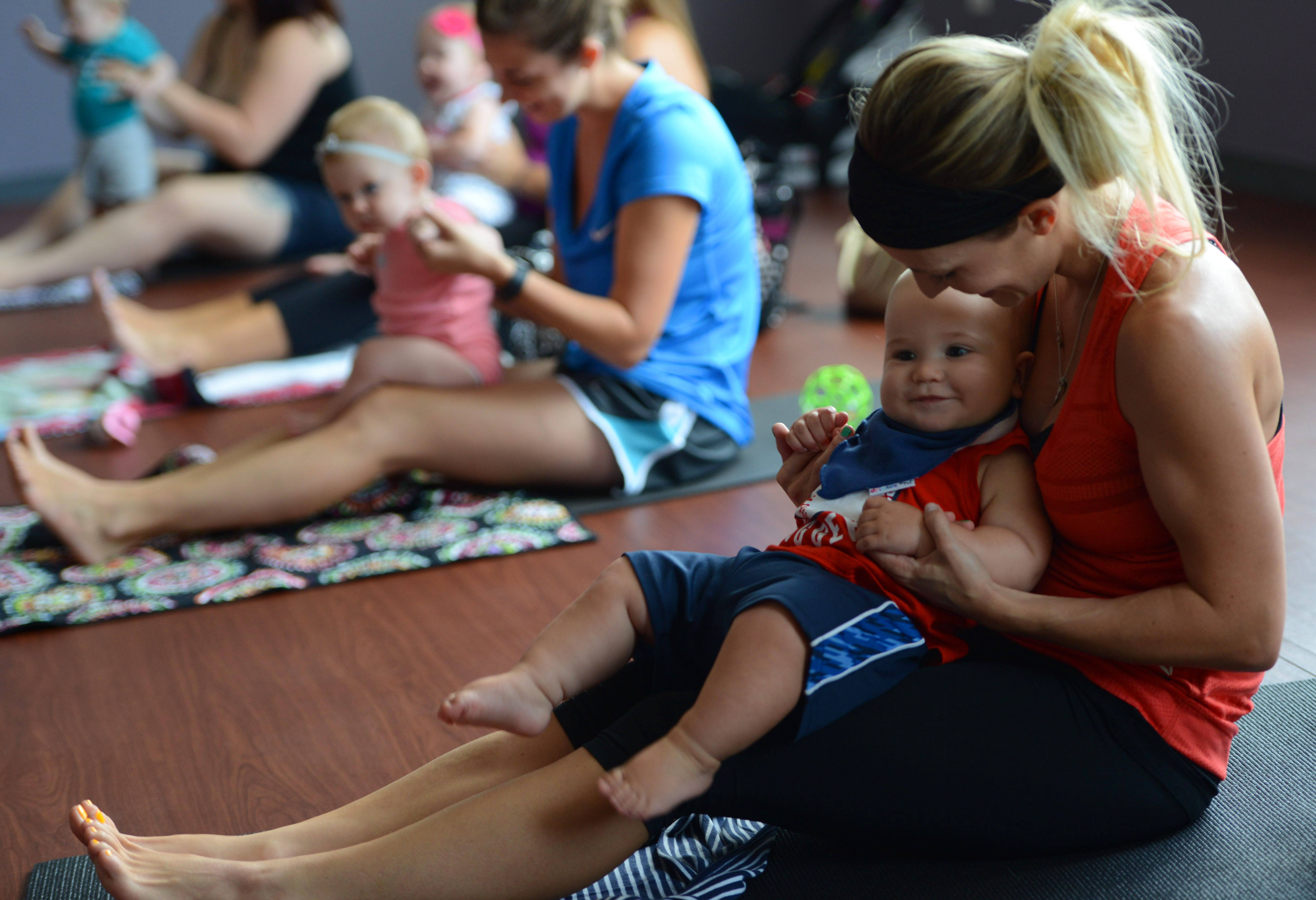 Rebecca Seidling of Lake in the Hills bounces her 8-month-old son, Vincent, on her lap Friday during Liz Gregerson's ohm Mother baby yoga class in West Dundee.